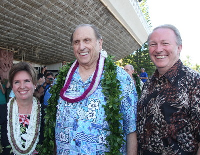President Thomas S. Monson, center, is welcomed to the Polynesian Cultural Center by its president Von Orgill, right, and his wife, Sister Sherri Orgill.