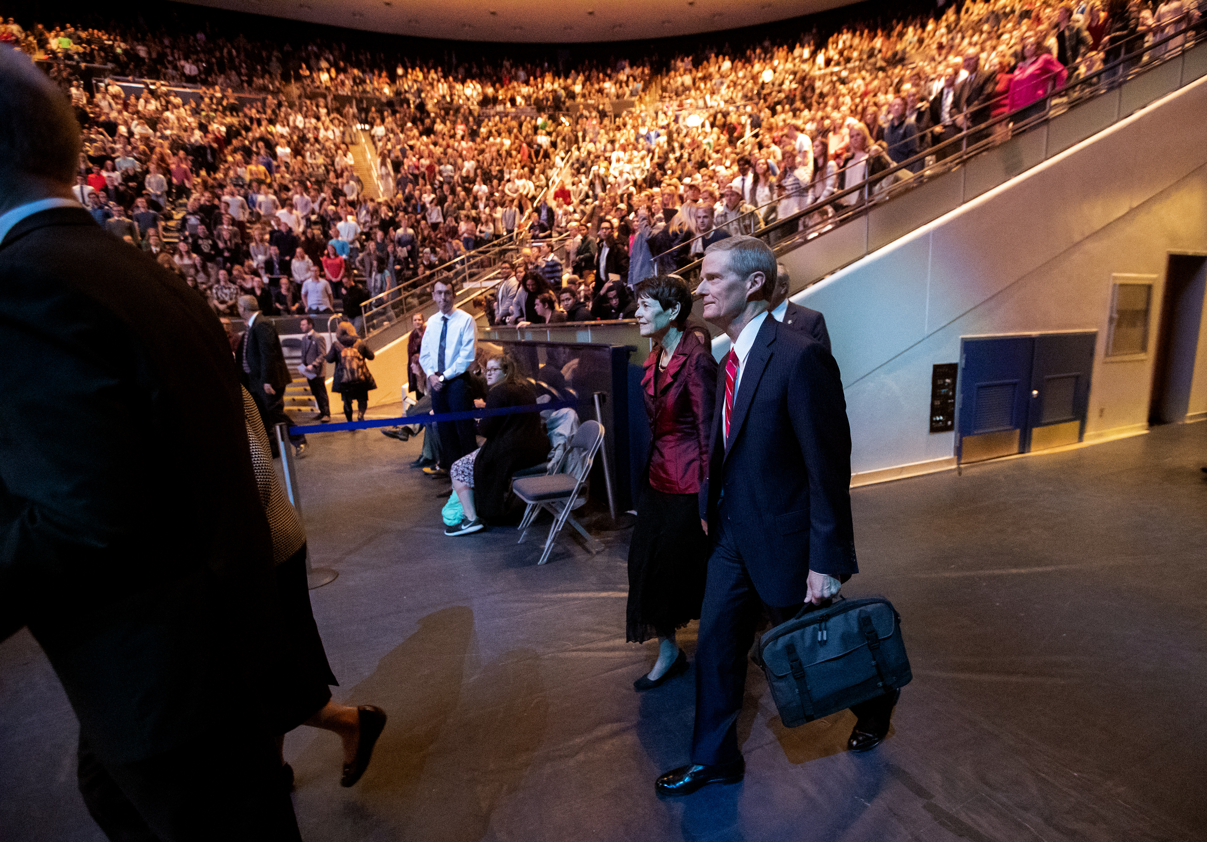 Elder David A. Bednar of the Quorum of the Twelve Apostles of The Church of Jesus Christ of Latter-day Saints and his wife, Sister Susan Bednar, enter the arena as they attend the campus devotional in the Marriott Center at BYU in Provo on Tuesday, Dec. 4, 2018.