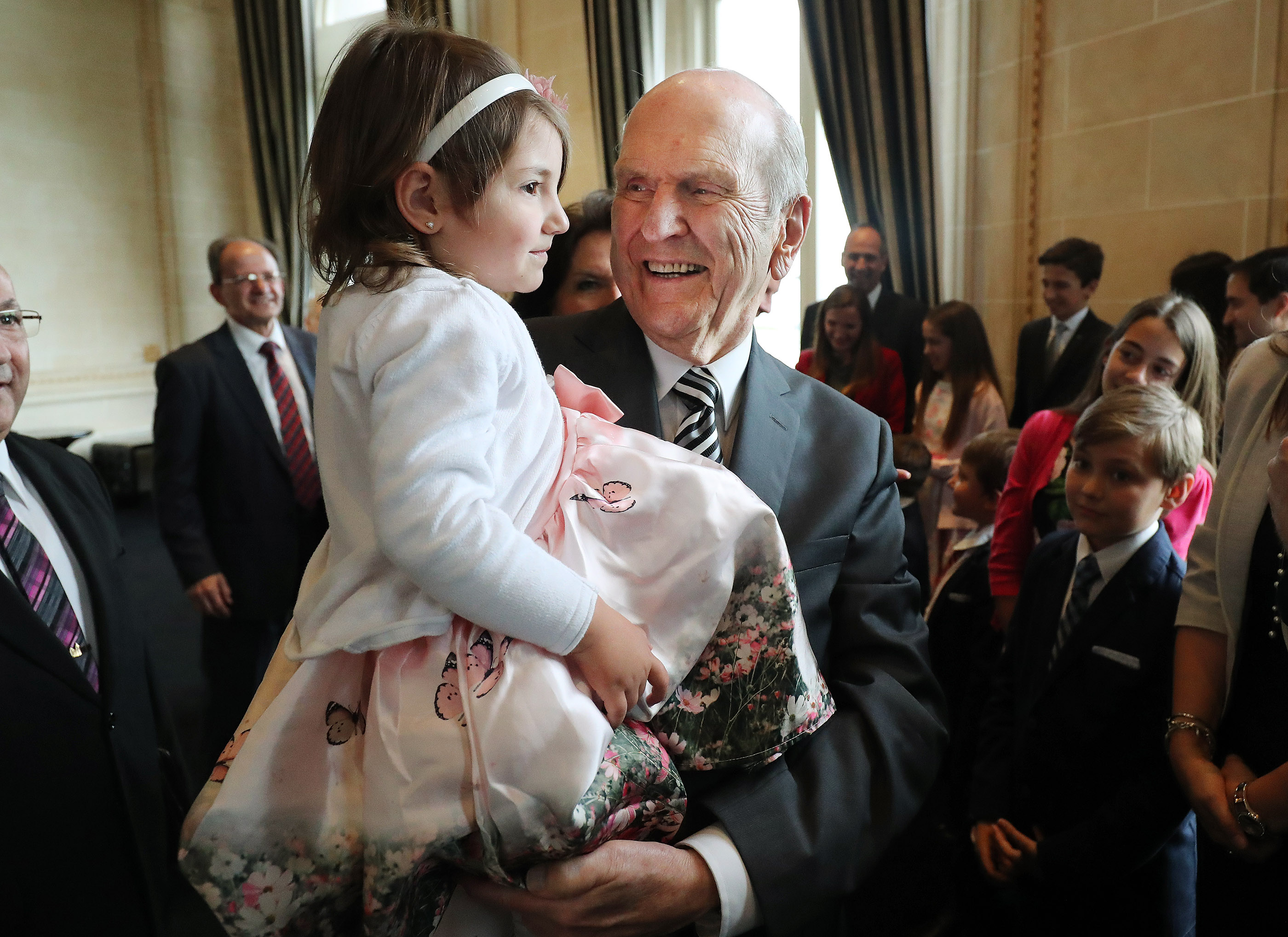 President Russell M. Nelson of The Church of Jesus Christ of Latter-day Saints holds Pierina Risso, age 3, while meeting with her four-generation Latter-day Saint family in Montevideo, Uruguay, on Thursday, Oct. 25, 2018.