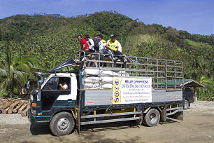A truck carries supplies from Latter-day Saint Charities, which worked with other organizations to help flood victims of Typhoon Maring in the Philippines.