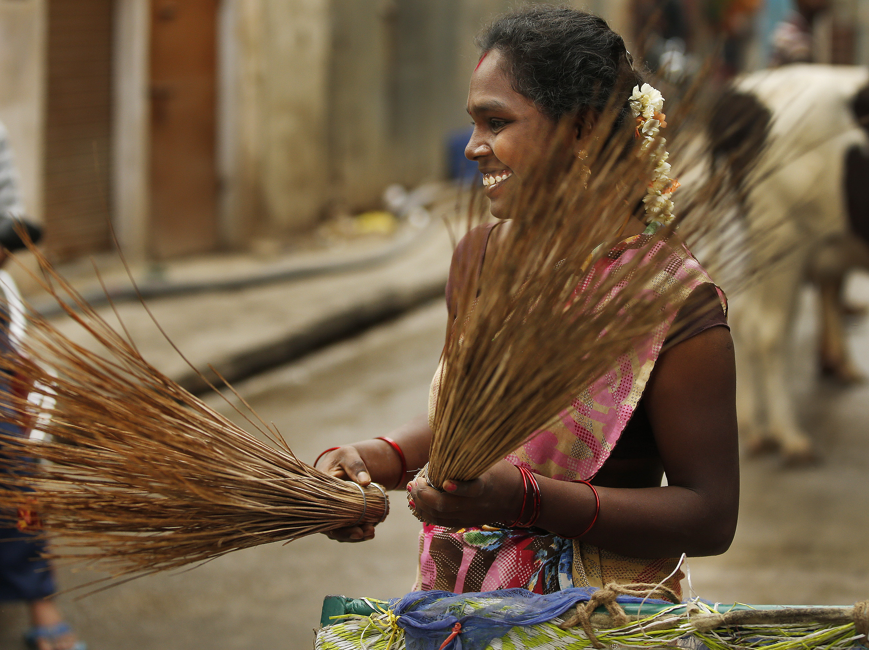 A woman prepares to sweep a street in Bengaluru, India, on Thursday, April 19, 2018.