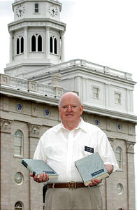 Elder Ron Prince stands ouside near the Nauvoo Temple holding the Journals of his great-great-grandfather Josiah Stout, Josiah was one of the people who worked on the original temple. Photo by Scott G. Winterton/Deseret News April 30, 2002. (Submission date: 04/30/2002)