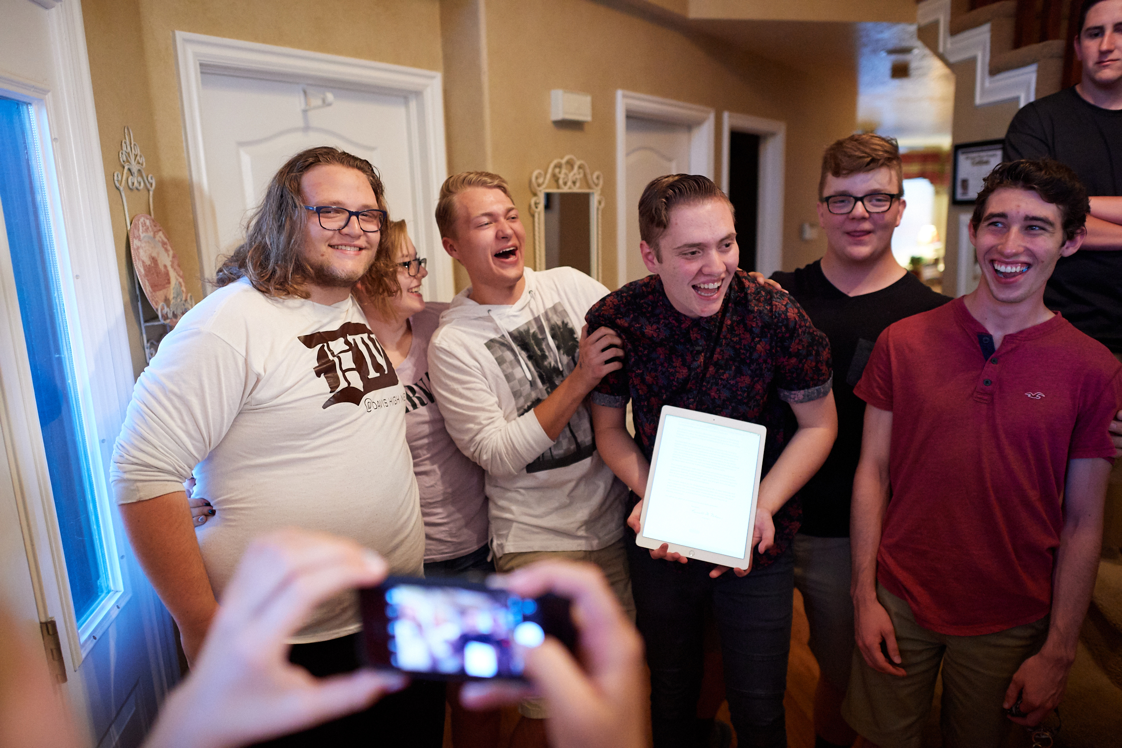 Enthusiastic friends share in the moment of hearing where their friend, Billy, will be serving a two year mission for The Church of Jesus Christ of Latter-day Saints. His call to serve came by way of email rather than in the mail.