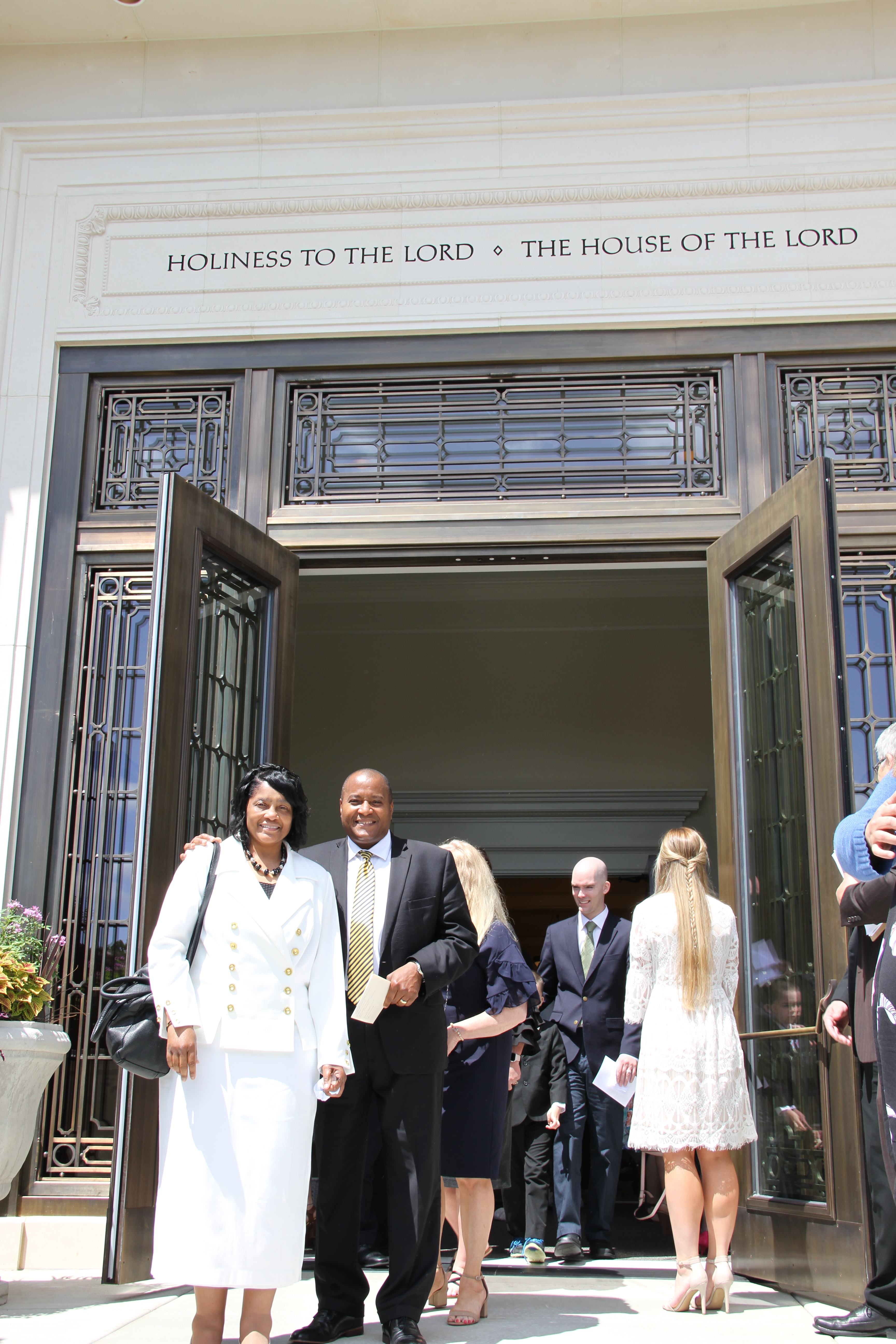 Bishop Ivon and Sister Ann Faulkner pose outside the Memphis Tennessee Temple following the temple rededication on May 5, 2019.