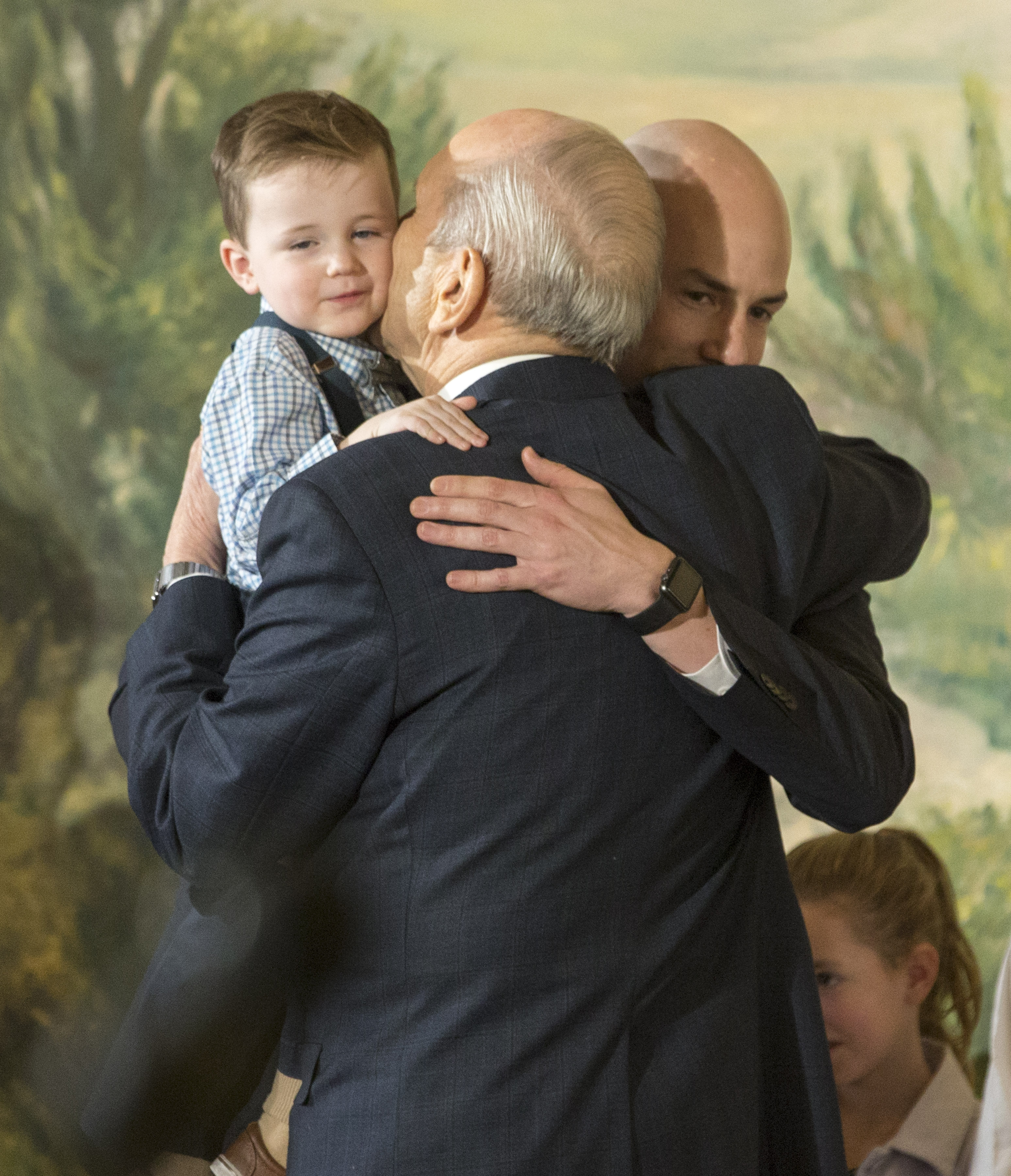 President Russell M. Nelson, 17th President of The Church of Jesus Christ of Latter-day Saints, receives hugs from family members after he and his councilors, President Dallin H. Oaks, first counselor, and President Henry B. Eyring, second counselor, held a press conference at the Church Office Building in Salt Lake City Utah on Tuesday, Jan. 16, 2018.
