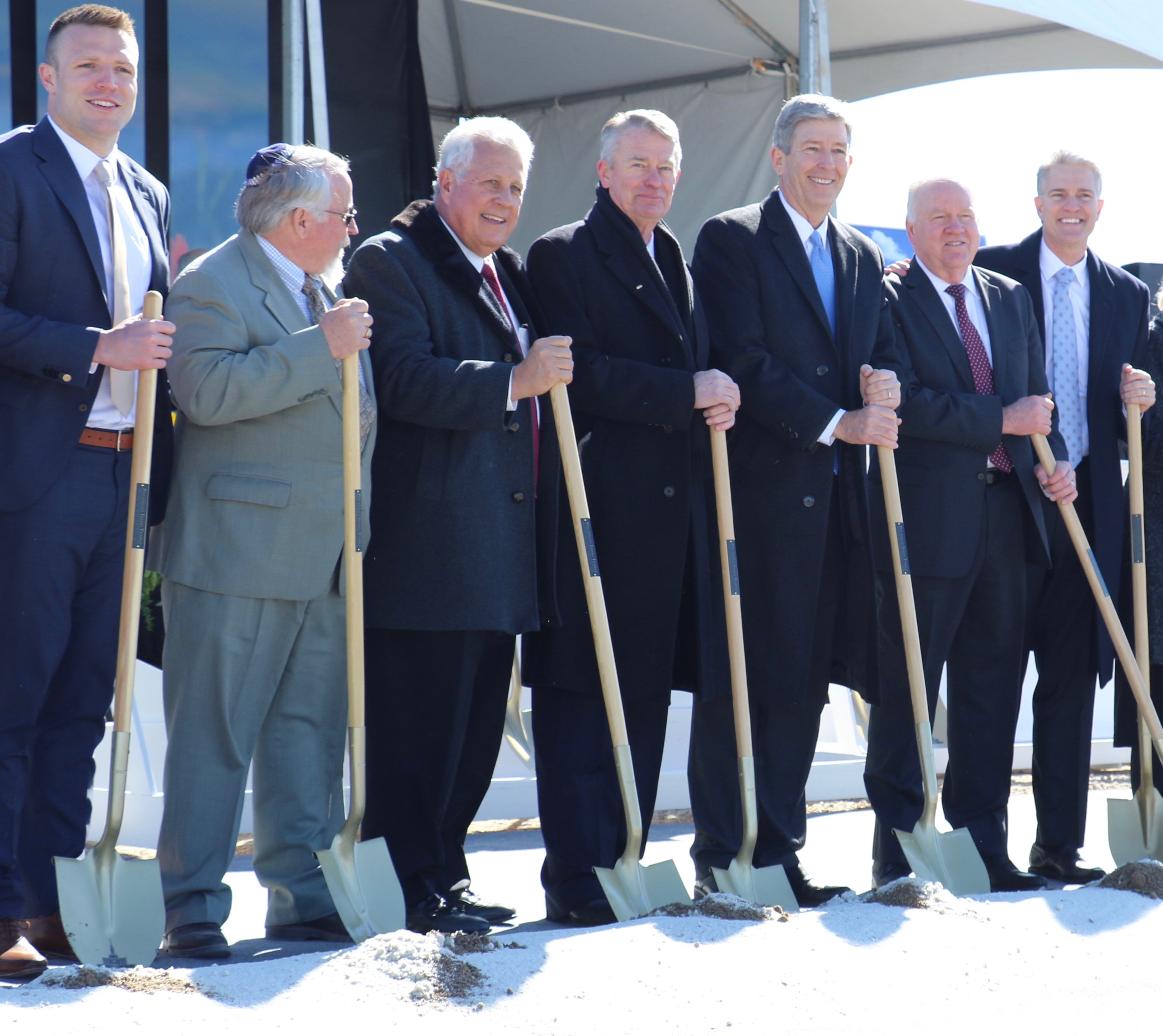 A collection of representatives from religious, civic and athletic communities turn over ceremonial shovels of soil at the March 16, 2019, groundbreaking service of the Pocatello Idaho Temple. Participants include football star Taysom Hill, Idaho Governor Brad Little, Elder Wilford W. Andersen, Elder S. Gifford Nielsen and Elder Brian K. Taylor.
