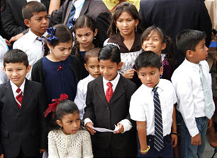 Little children gather for the cornerstone ceremony of the Tegucigalpa Honduras Temple dedication.