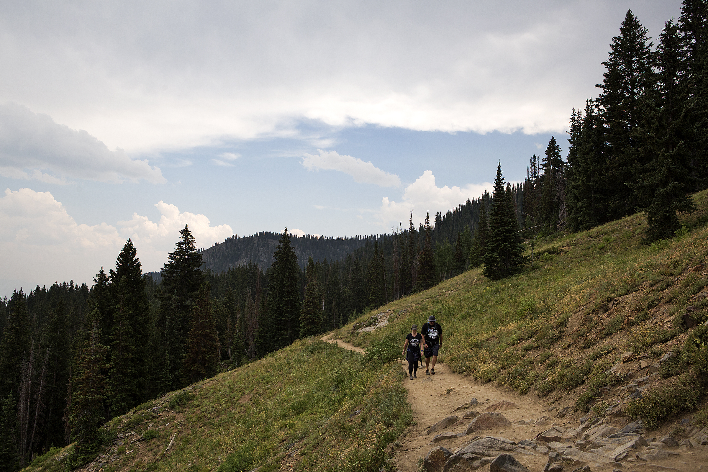 Ryan Anderson, right, and Rickale Sceili hike through the Bonanza Flat Conservation Area near Park City on Friday, Aug. 3, 2018.