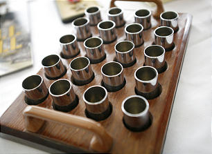 Memorabilia, including these sacrament cups made of shell casings, were on display at the Saints at War conference.