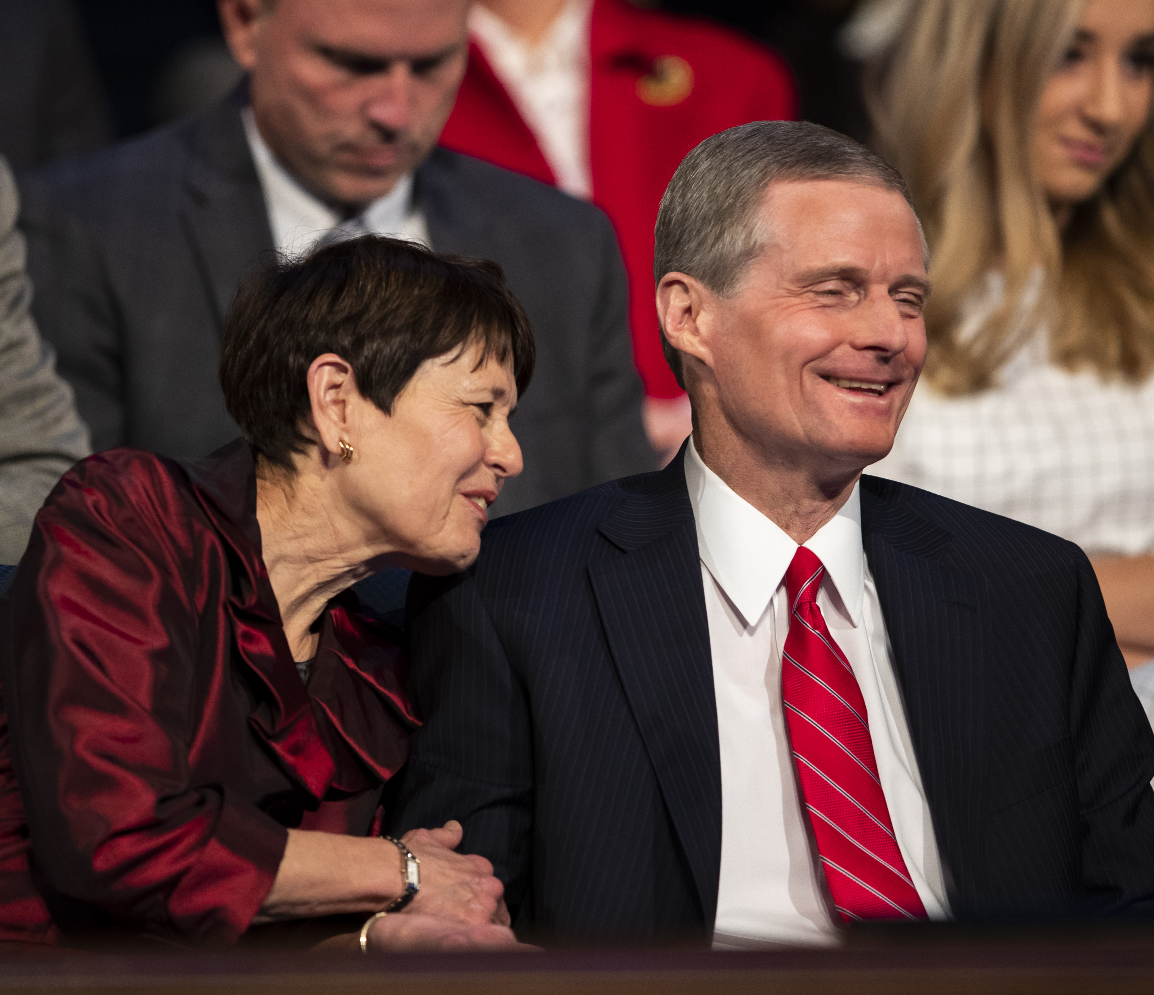 Elder David A. Bednar of the Quorum of the Twelve Apostles of The Church of Jesus Christ of Latter-day Saints and his wife, Sister Susan Bednar, share a laugh as they attend the campus devotional in the Marriott Center at BYU in Provo on Tuesday, Dec. 4, 2018.