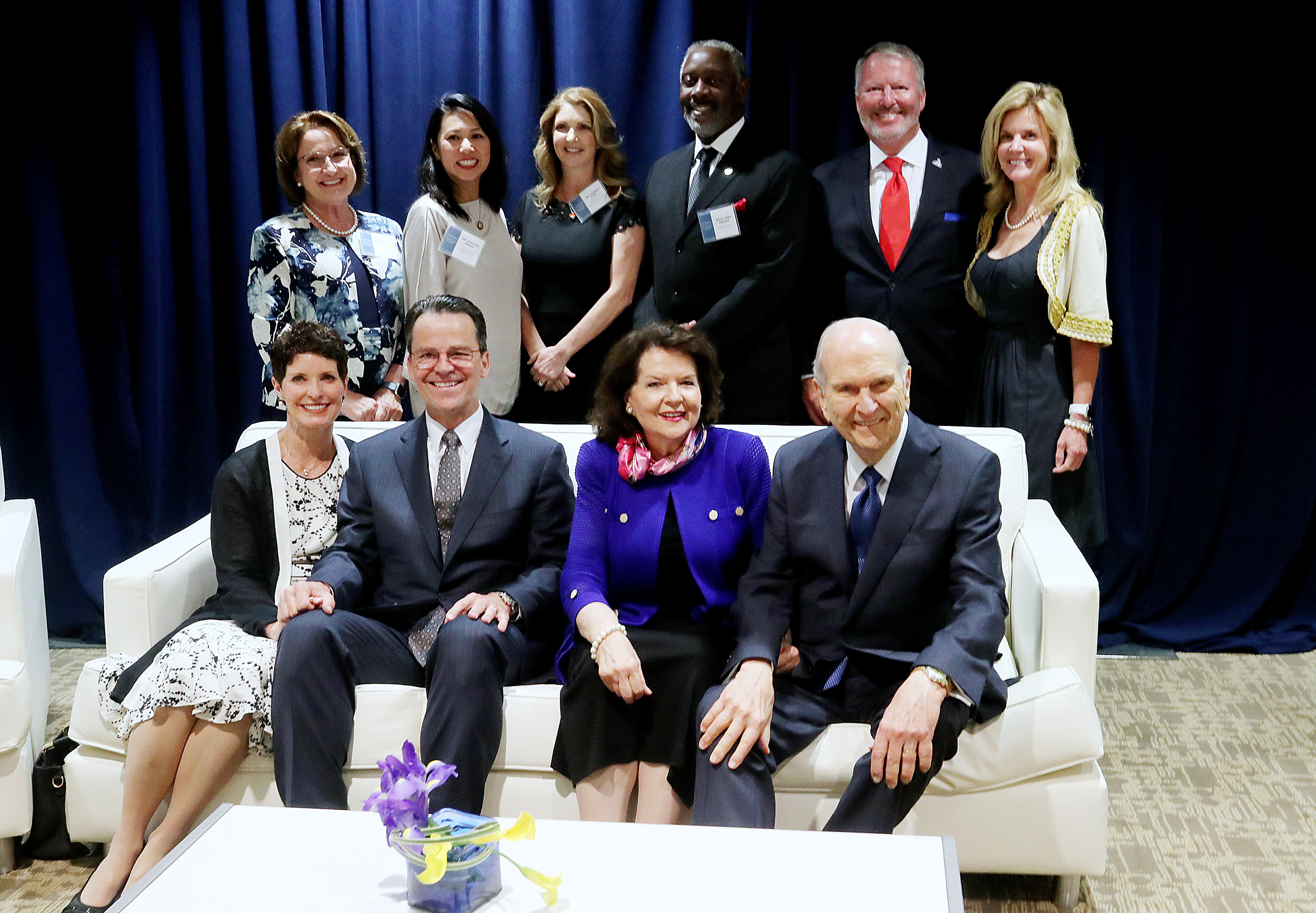 Seated from right to left on the front, President Russell M. Nelson, Sister Wendy Nelson, Elder Shayne M. Bowen and Sister Lynette Bowen pose for a photo with local leaders and VIPs at the Amway Center in Orlando, Florida, prior to a devotional on Sunday, June 9, 2019.