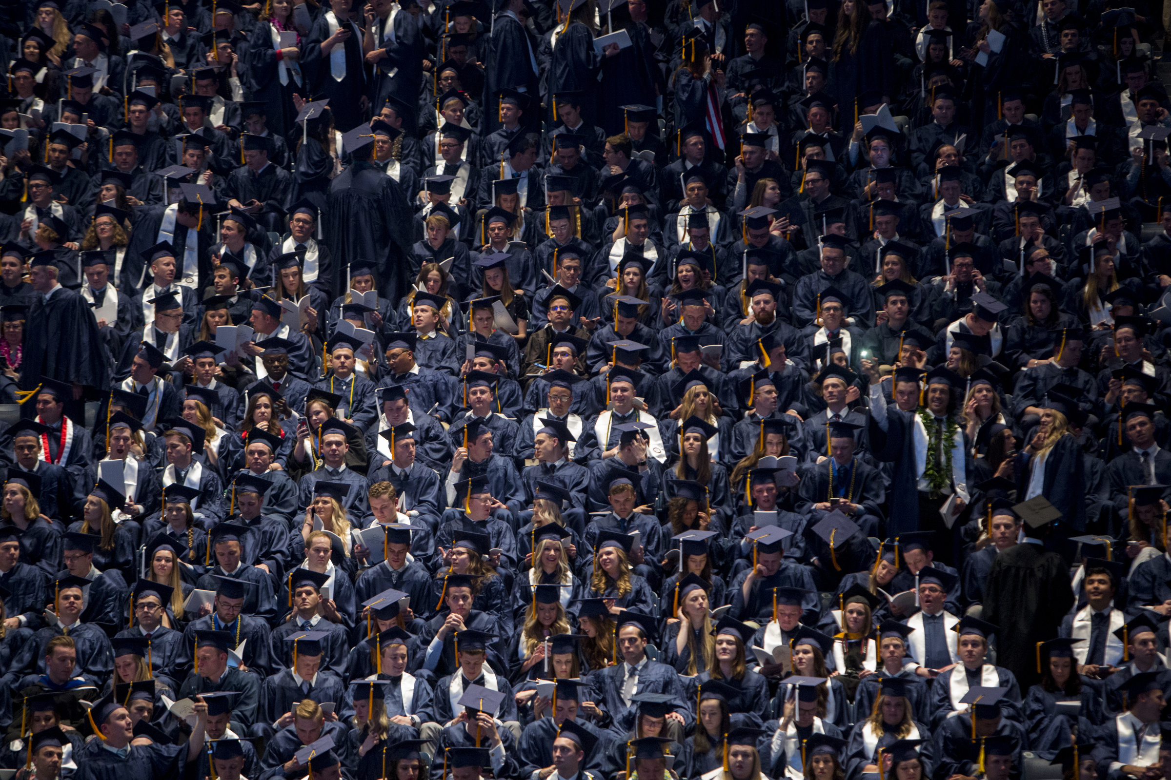 Graduates wait for the start of Brigham Young University's commencement ceremony in the Marriott Center on Thursday, April 26, 2018, in Provo. BYU is awarding nearly 6,300 degrees to graduates this week.