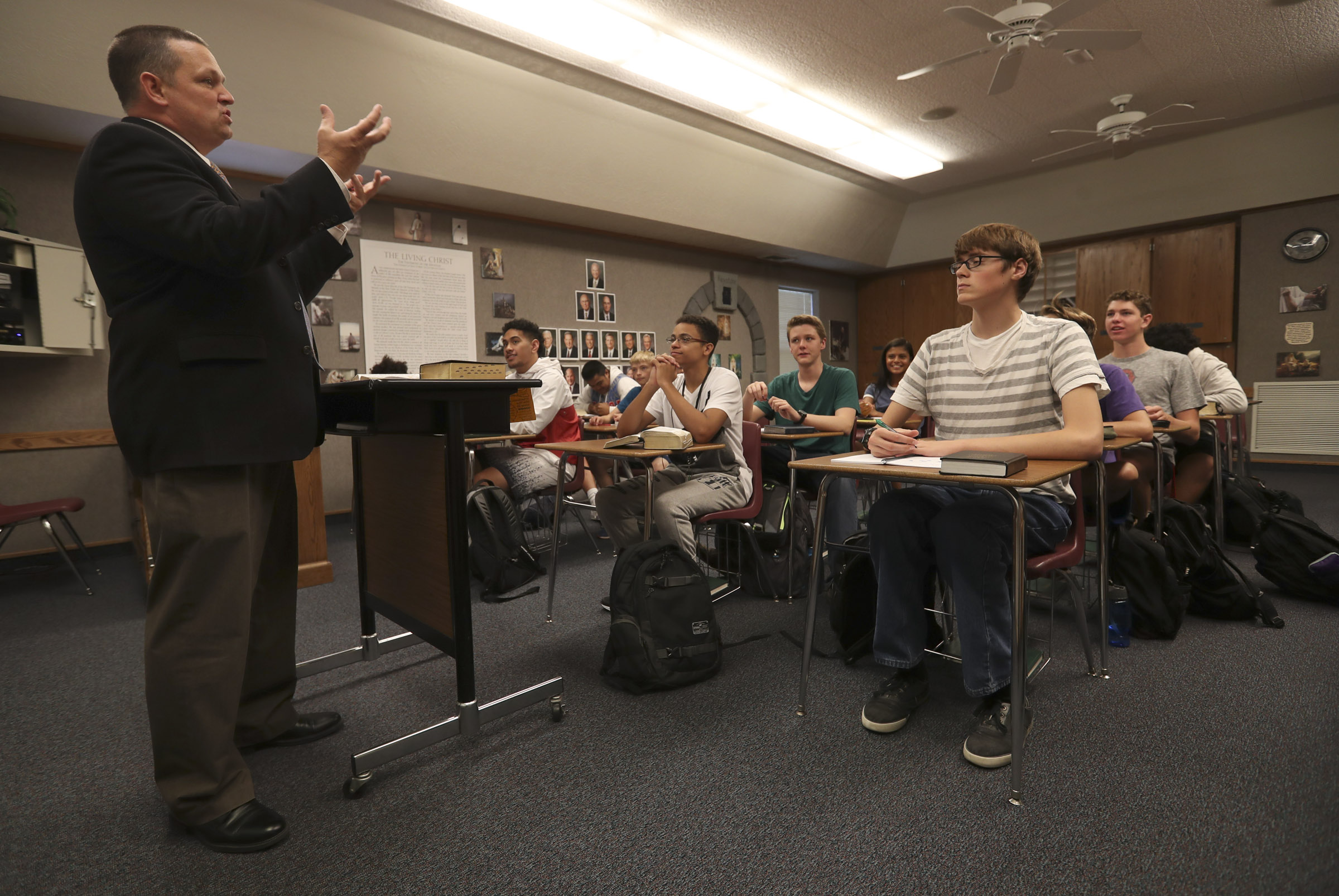 West High's Seminary principal, Trent Smith, talks with his students during an LDS seminary class at West High School in Salt Lake City on Monday, Sept. 17, 2018.