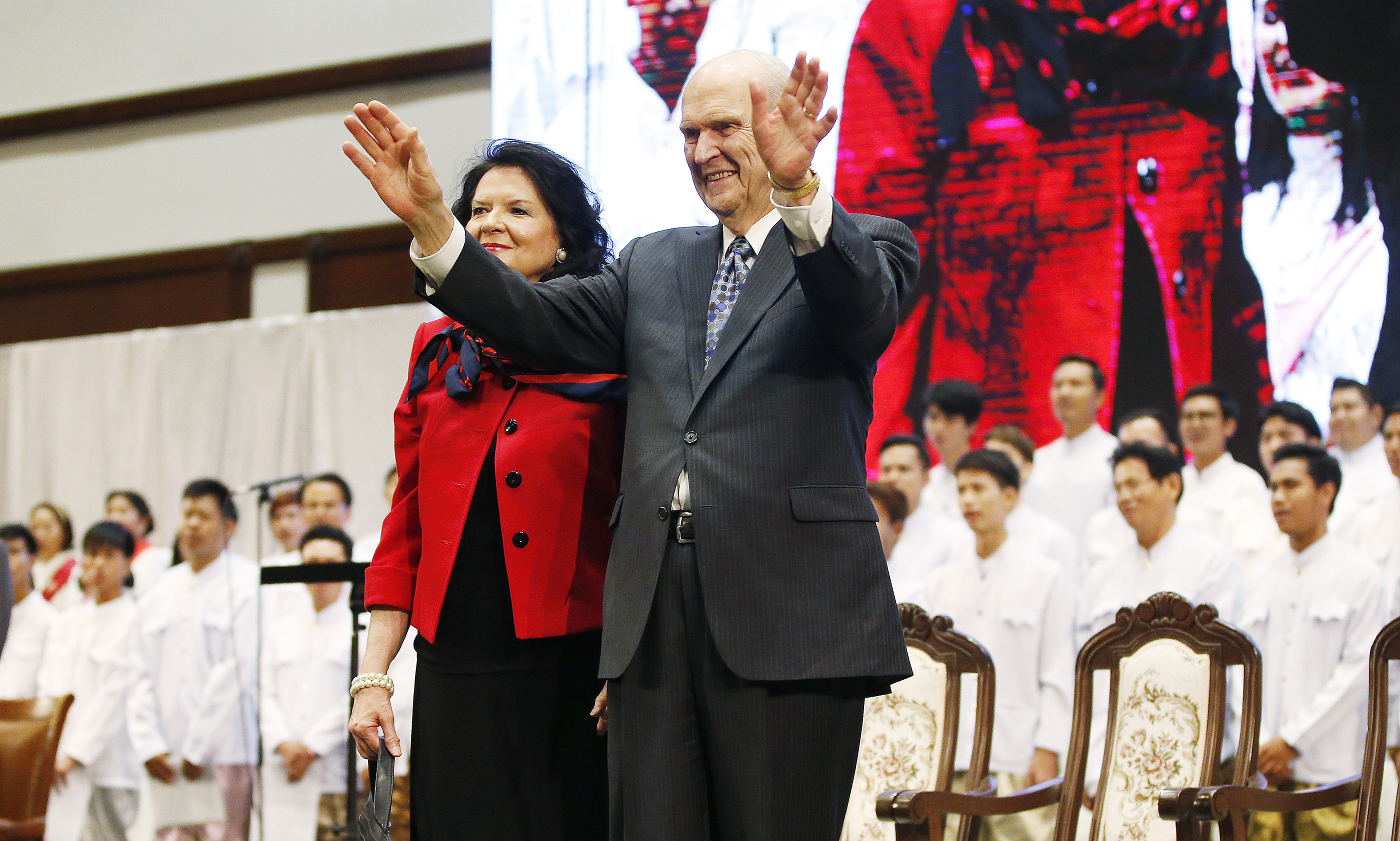 Russell M. Nelson, President of The Church of Jesus Christ of Latter-day Saints, and his wife, Sister Wendy Nelson, wave to attendees after a devotional in Bangkok, Thailand, on Friday, April 20, 2018.