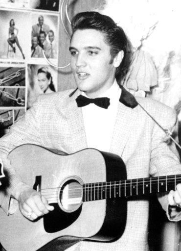 In this April 30, 1956, file photo, Elvis Presley is shown at the New Frontier Hotel in Las Vegas. One of the first stages Elvis sang on has been refinished during the renovation of the auditorium at his elementary school in Tupelo, Miss., the Northeast Mississippi Daily Journal reported Friday, July 21, 2017. Elvis Presley Birthplace employee Judy Schumpert says the rock 'n' roll king's time at Lawhon was instrumental in helping him pursue music as a boy. Schumpert says Presley's fifth-grade teacher, Oleta Grimes, entered him in his first talent competition.