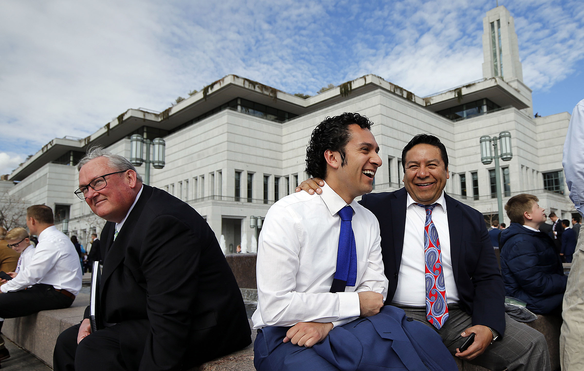 Mario Hernandez, right, laughs with his son, Ray, before Saturday's priesthood session of the 189th Annual General Conference of The Church of Jesus Christ of Latter-day Saints in the Conference Center in Salt Lake City on Saturday, April 6, 2019.