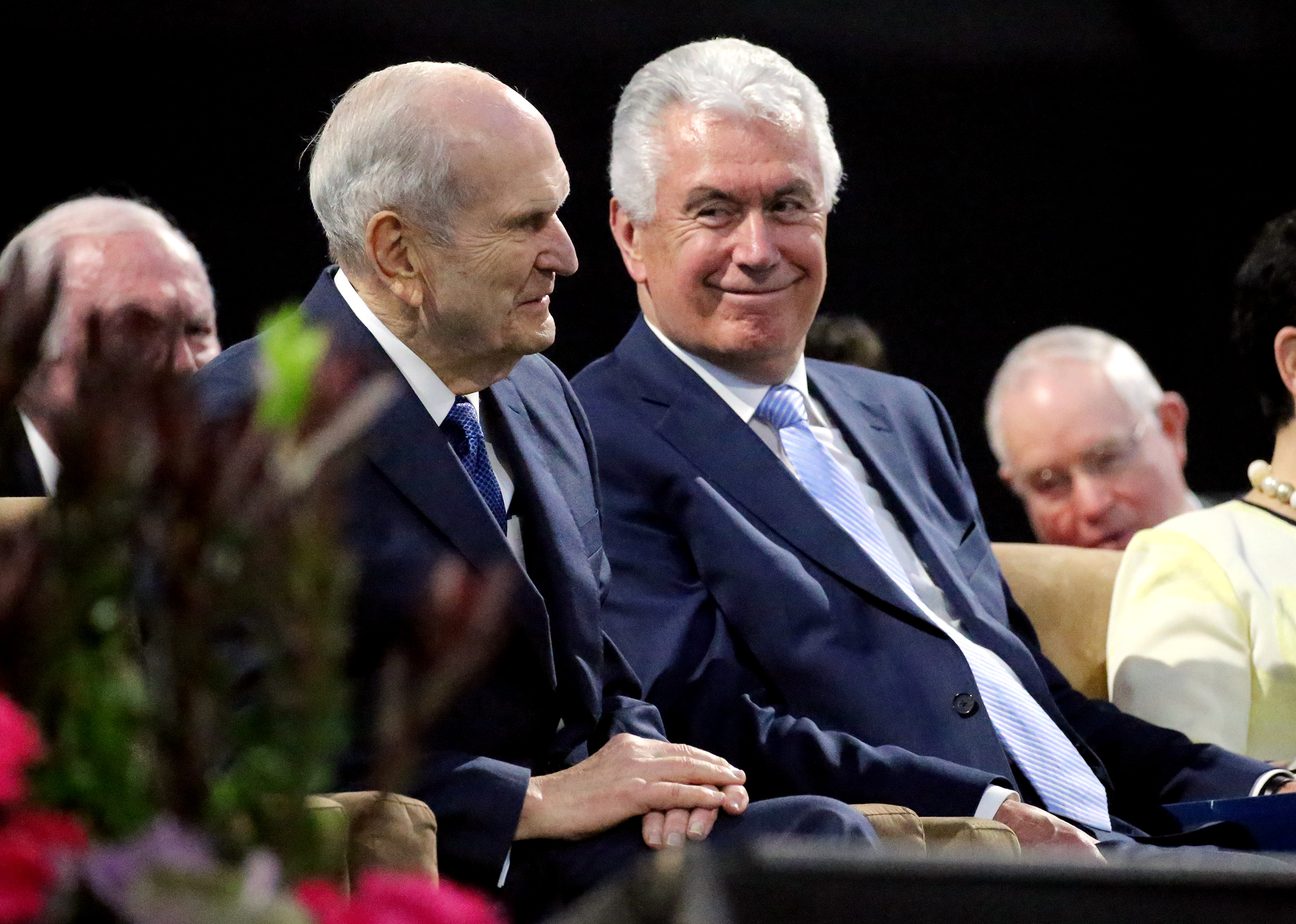 President Russell M. Nelson and Elder Dieter F. Uchtdorf of the Quorum of the Twelve Apostles share a smile during the devotional at the Amway Center in Orlando, Florida, on Sunday, June 9, 2019.