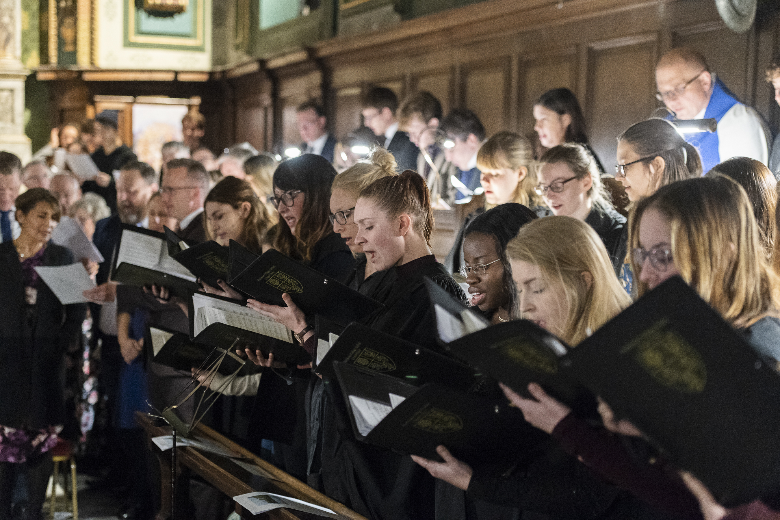 """The Pembroke College Chapel Choir and congregation sing a Christmas hymn during the traditional Church of England """"Nine Lessons and Carols"""" service at the Pembroke College Chapel in Oxford, England, on Sunday, Nov. 25, 2018."""