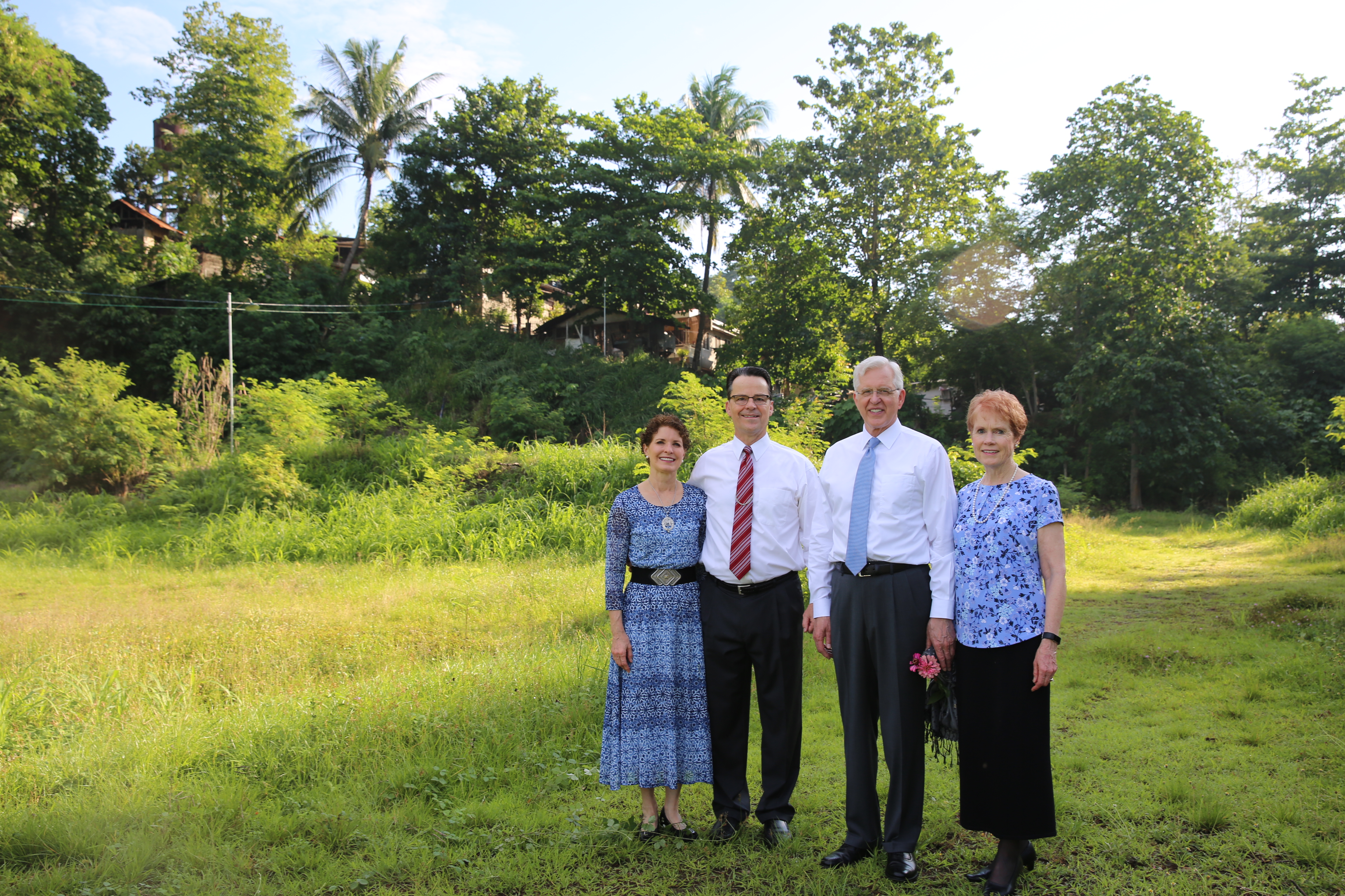 Elder D. Todd Christofferson and his wife, Sister Kathy Christofferson, right, visit the future site of a temple in Cagayan de Oro, Philippines, with Elder Shayne M. Bowen and Sister Lynette Bowen.