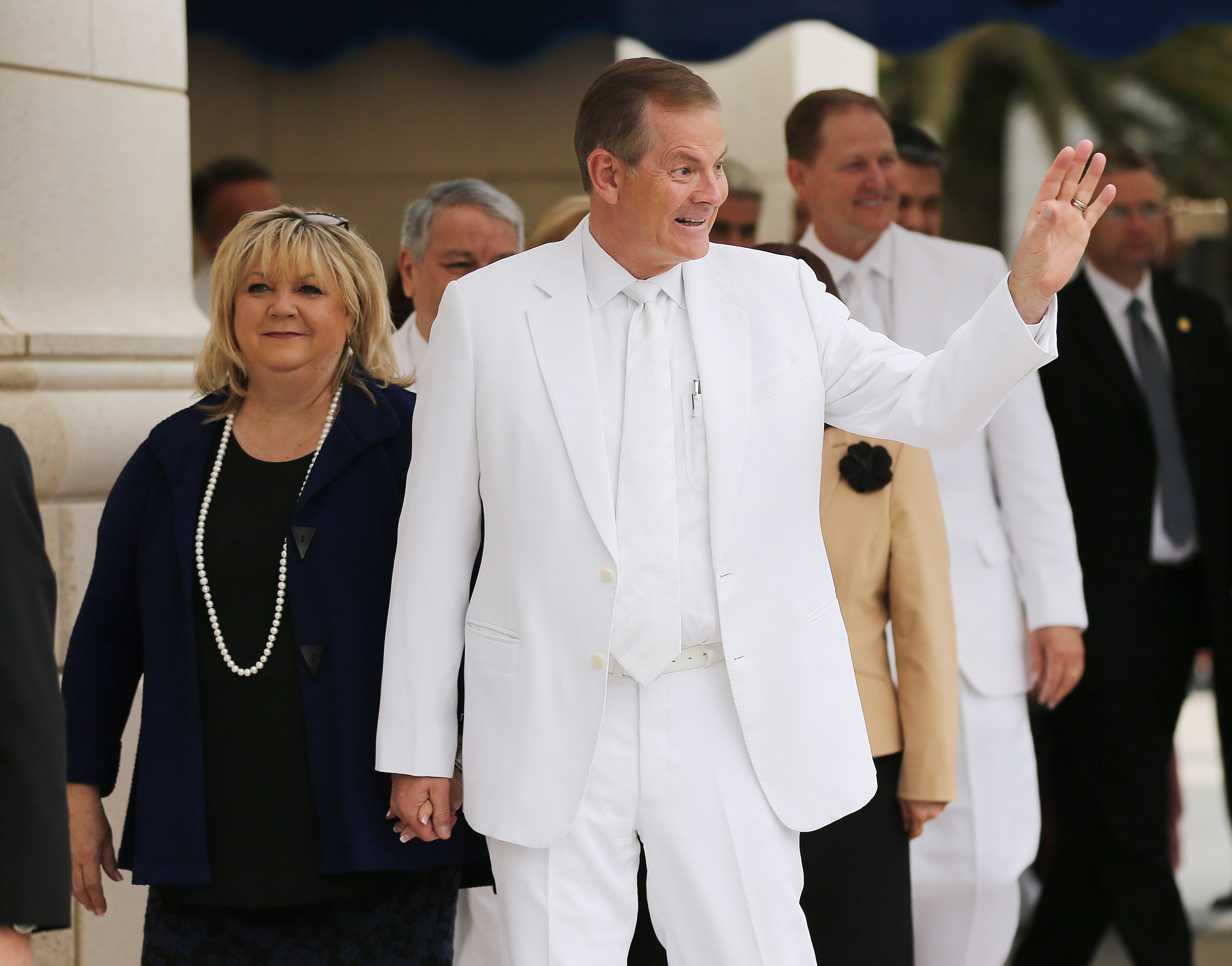 Elder Gary E. Stevenson of the Quorum of the Twelve Apostles and his wife, Sister Lesa Stevenson, wave during the dedication of the Concepcion Chile Temple in Concepcion, Chile, on Sunday, Oct. 28, 2018.