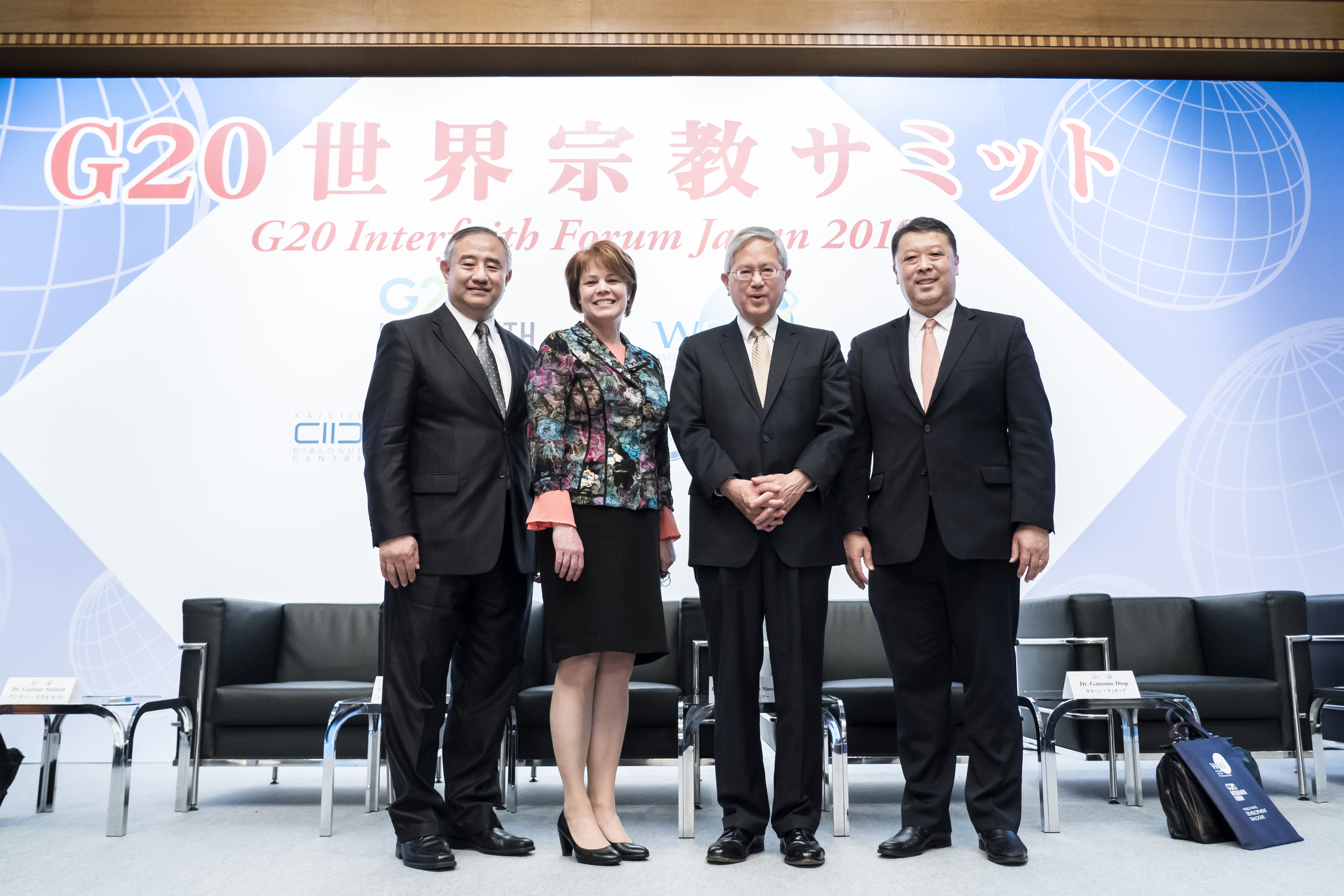 Elder Gerrit W. Gong of the Quorum of the Twelve Apostles of The Church of Jesus Christ of Latter-day Saints, center right, poses for a photograph during the G20 Interfaith Forum in Chiba, Japan, on Saturday, June 8, 2019.