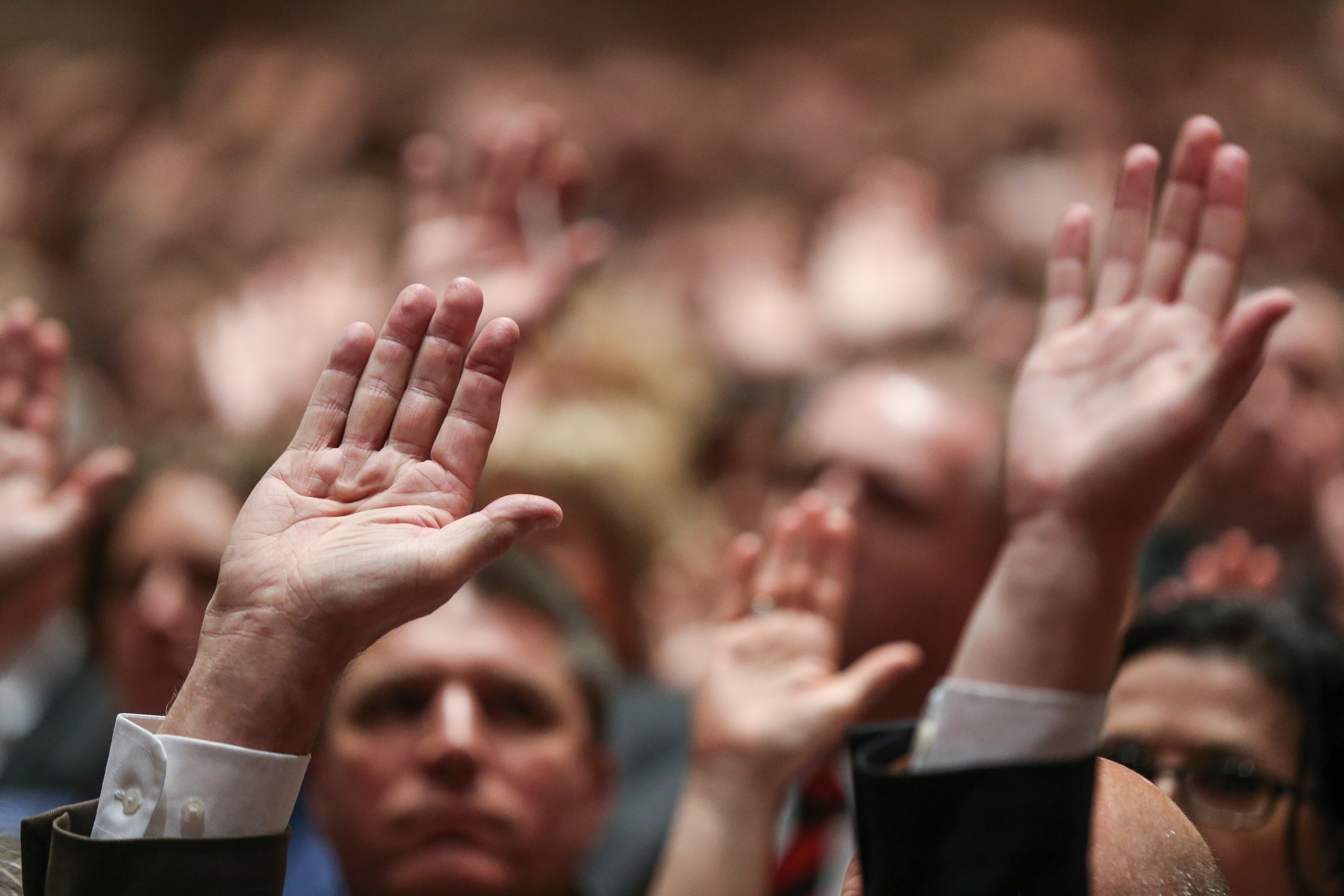 Conferencegoers raise their hands to sustain Church leadership during the Saturday afternoon session of the 188th Annual General Conference at the Conference Center in Salt Lake City on March 31, 2018.