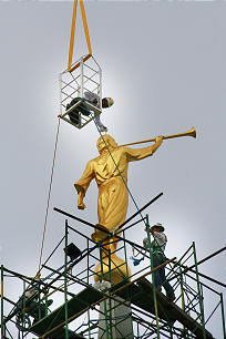 The statue of Moroni is hoisted high atop the Cebu City Philippines Temple.