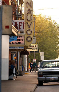 Businesses on Mulholland street in Nauvoo Illinois will soon be teaming with visitors as= the Temple Open House begins, Two men stop to talk in the early morning hours on the sidewalk. Photo by Scott G. Winterton/Desertet News. (Submission date: 04/30/2002)