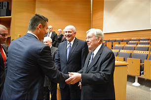 Elder M. Russell Ballard and Elder Richard J. Maynes greet priesthood leaders after a meeting in Madrid, Spain. The meeting was part of a five-country European trip Sept. 6 to Sept. 16.