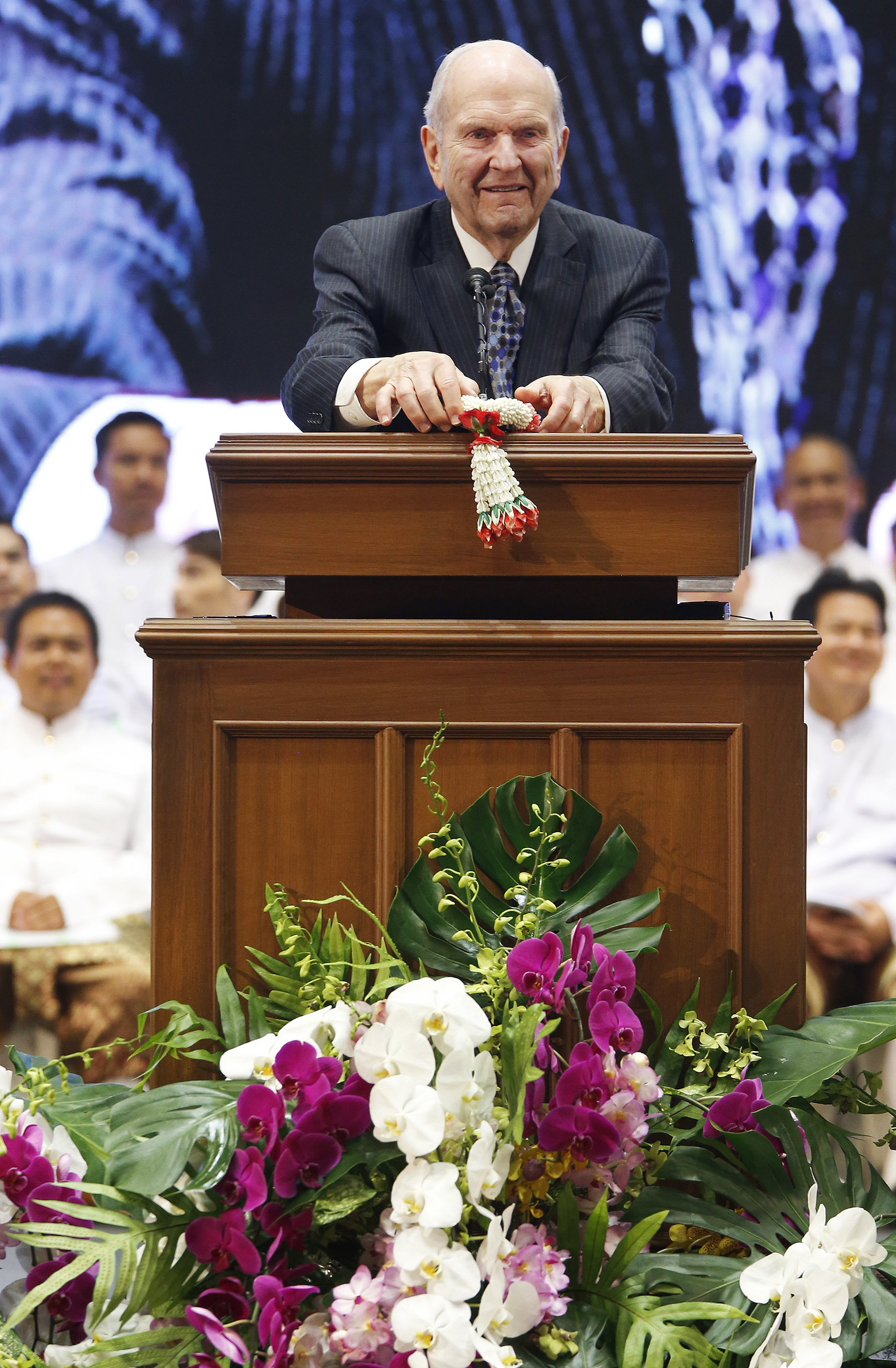 Russell M. Nelson, President of The Church of Jesus Christ of Latter-day Saints, displays flowers given to him in Bangkok, Thailand, prior to speaking on Friday, April 20, 2018.