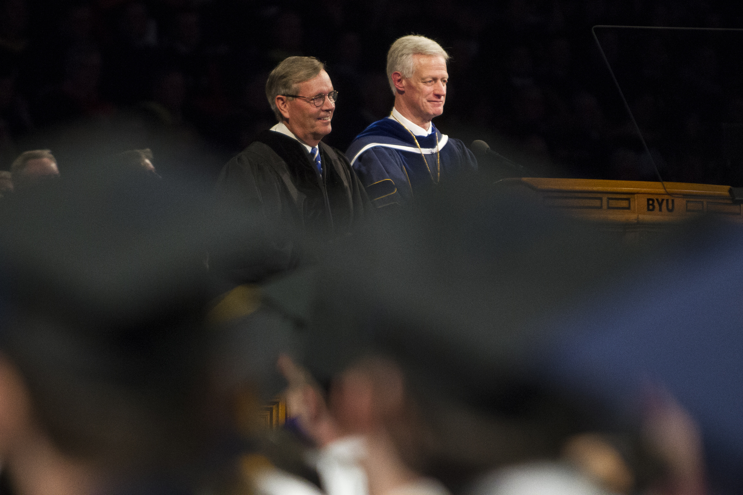 Former Utah Governor Mike Leavitt smiles next to BYU President Kevin Worthen while Leavitt is recognized with an honorary degree during Brigham Young University's commencement ceremony at the Marriott Center on Thursday, April 26, 2018, in Provo. BYU is awarding nearly 6,300 degrees to graduates this week.