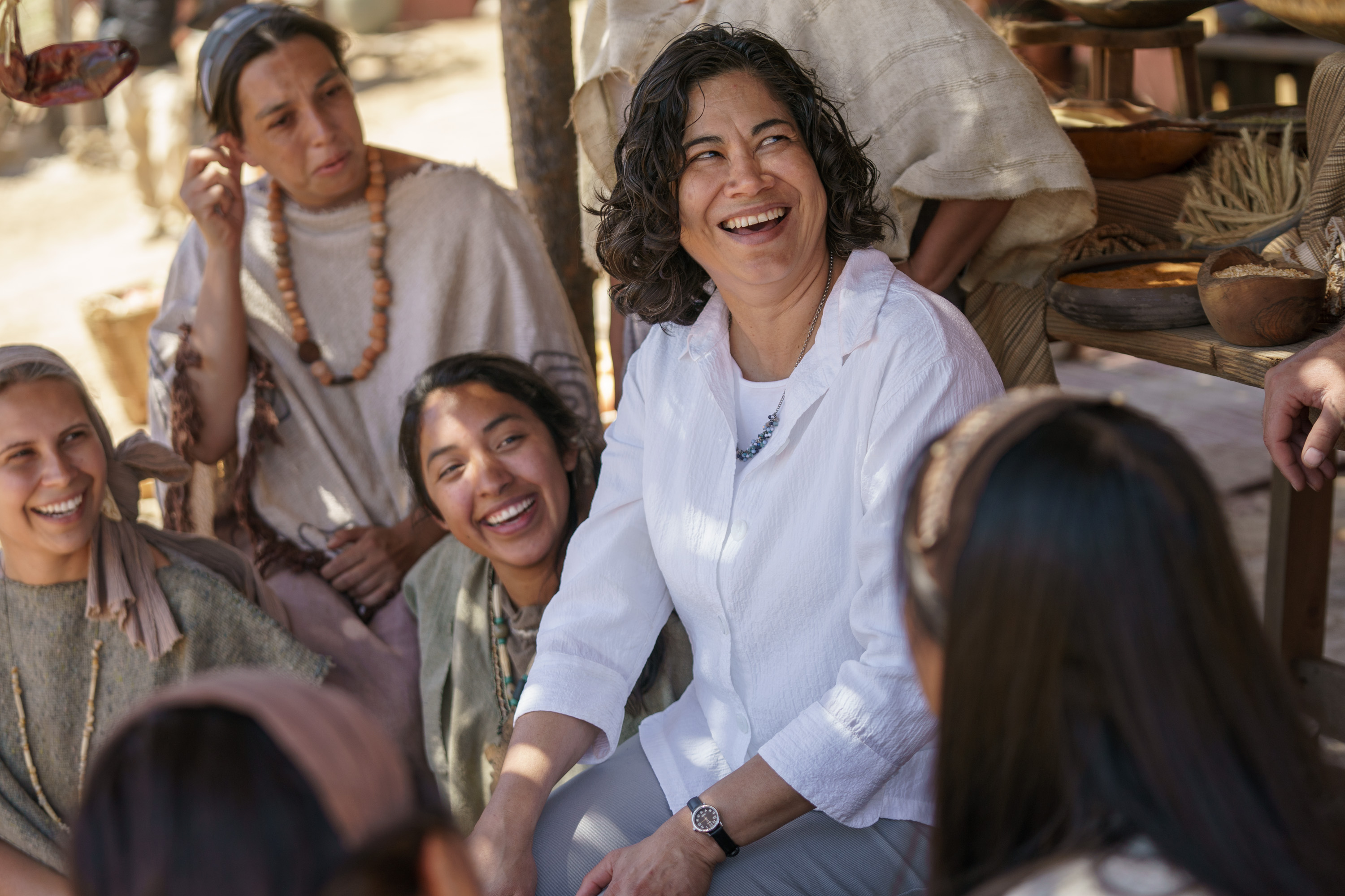 Sister Reyna I. Aburto, a member of the steering committee for the Book of Mormon Video Library project, talks with cast members on set near Springville, Utah, Friday, June 22, 2018.