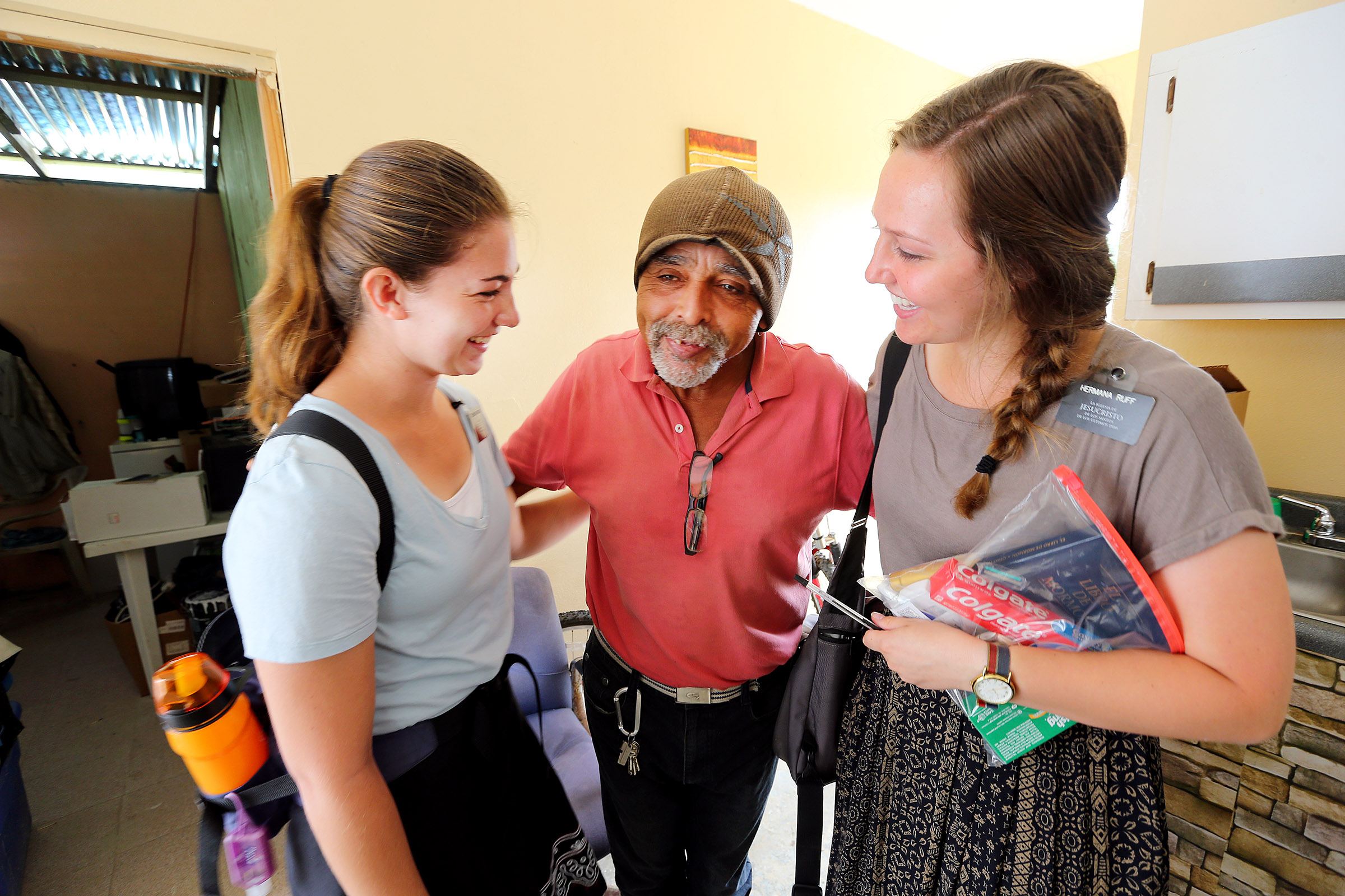 Sister's Erin Bianucci from Layton Utah, and Mary Ruff from Midvale Utah, receive a grateful hug from Eloy Rodriguez after they gave him a box of cleaning items and other necessities in Puerto Rico on Saturday, Feb. 17, 2018.