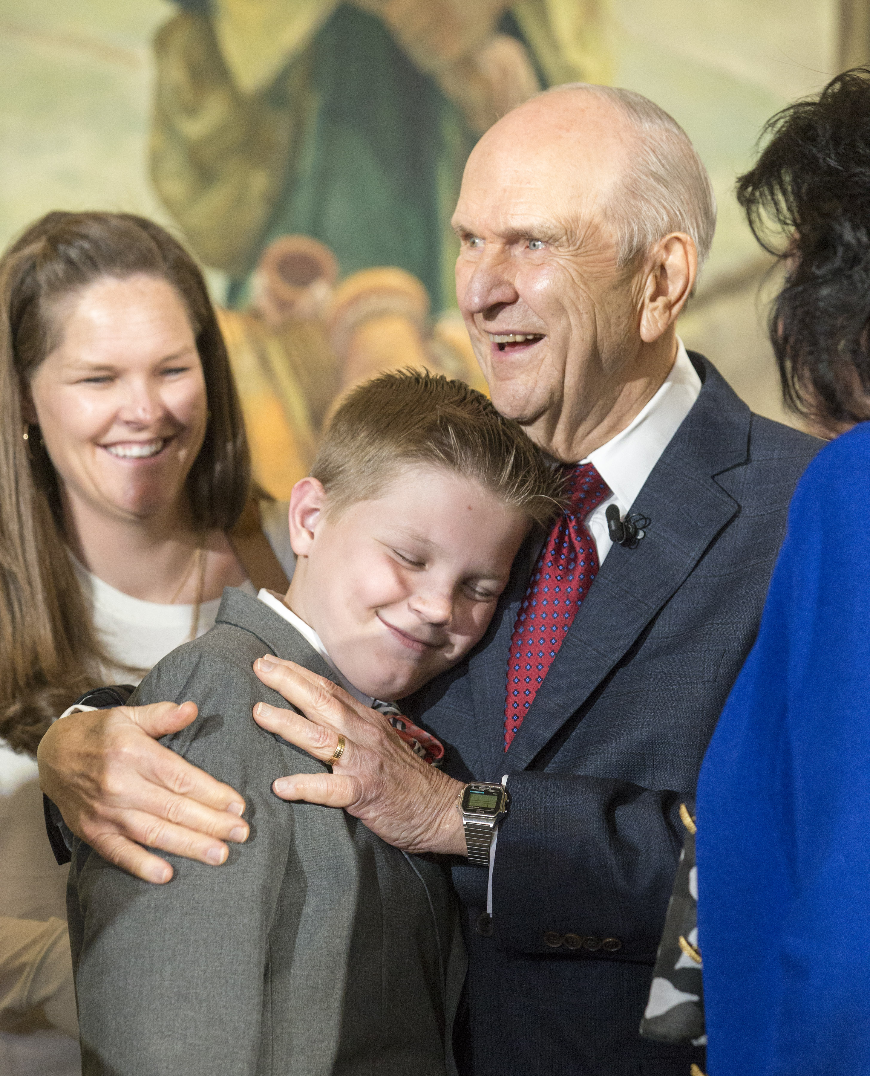 President Russell M. Nelson the 17th President of The Church of Jesus Christ of Latter-day Saints receive hugs from family members after he and his councilors President Dallin H. Oaks, first counselor and President Henry B. Eyring, second counselor held a press conference at the church office building in Salt Lake City Utah on Tuesday, Jan. 16, 2018.
