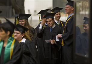 Gonzo Pastorini waits in line with other members of the LDS Business College Class of 2011 outside of the Tabernacle on Temple Square in Salt Lake City on Thursday, April 14, 2011.