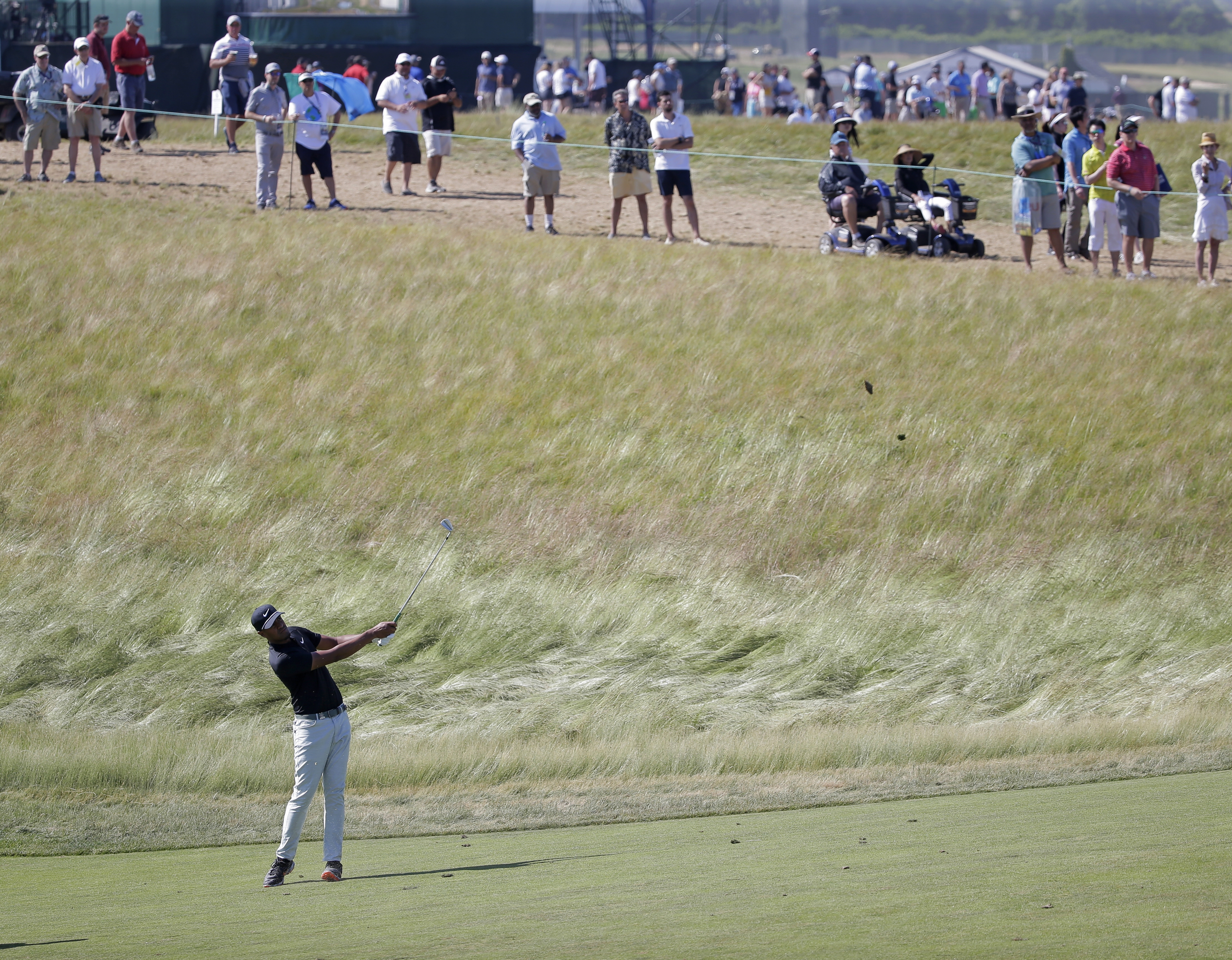 Tony Finau hits an approach shot on the ninth hole during the final round of the U.S. Open Golf Championship on June 17 in Southampton, N.Y.