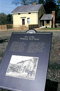 Plaque near Whitney home details contributions of Newel K. and Elizabeth Ann Whitney, early members who consecrated land to the Church. Newel also served as bishop.