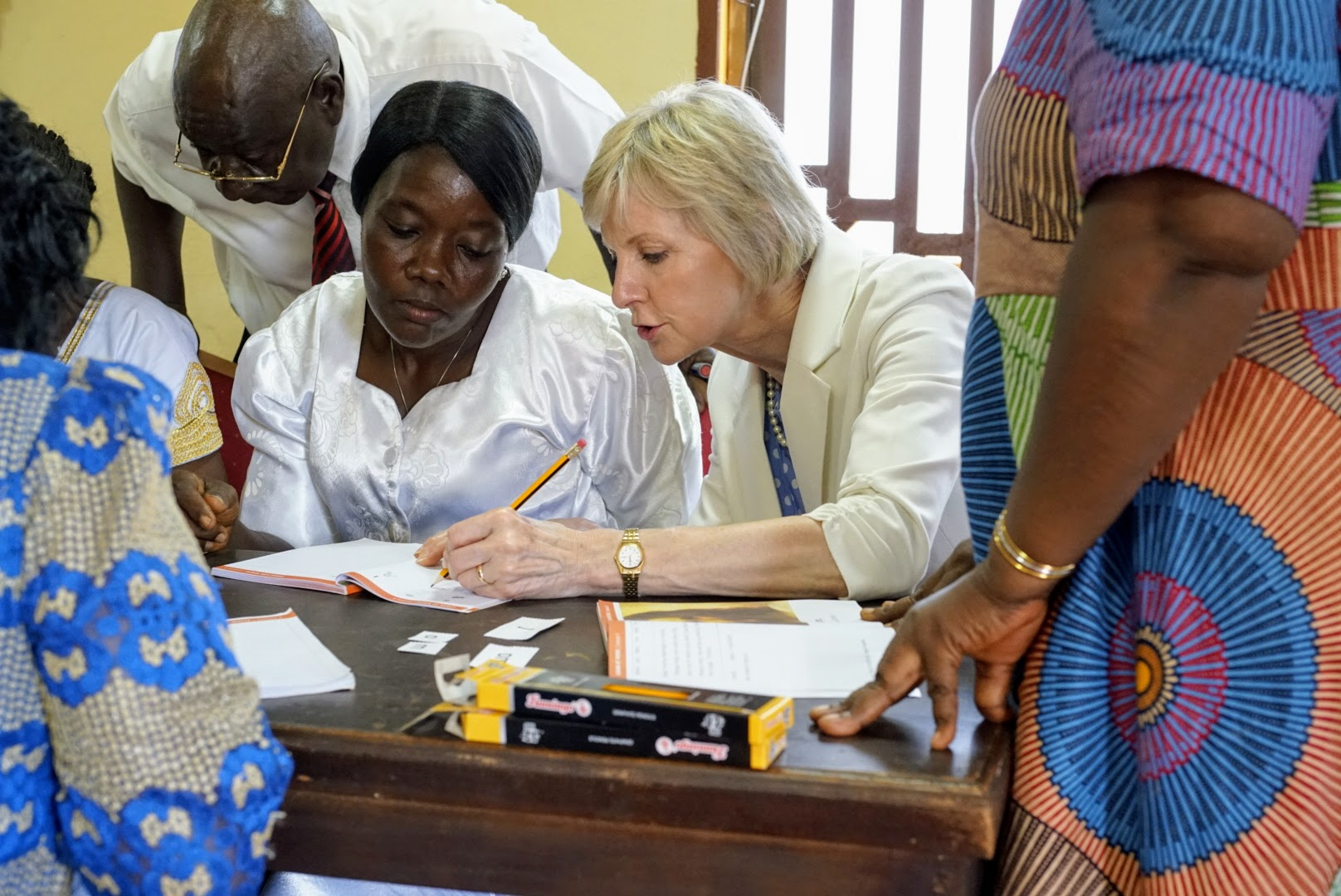 Sister Jean B. Bingham goes through some of the Gospel Literacy pilot program materials with members in Sierra Leone while visiting to observe the implementation of the Gospel Literacy program. Sister Bingham, Relief Society general president, visited the West African country June 5 through June 16, 2019.