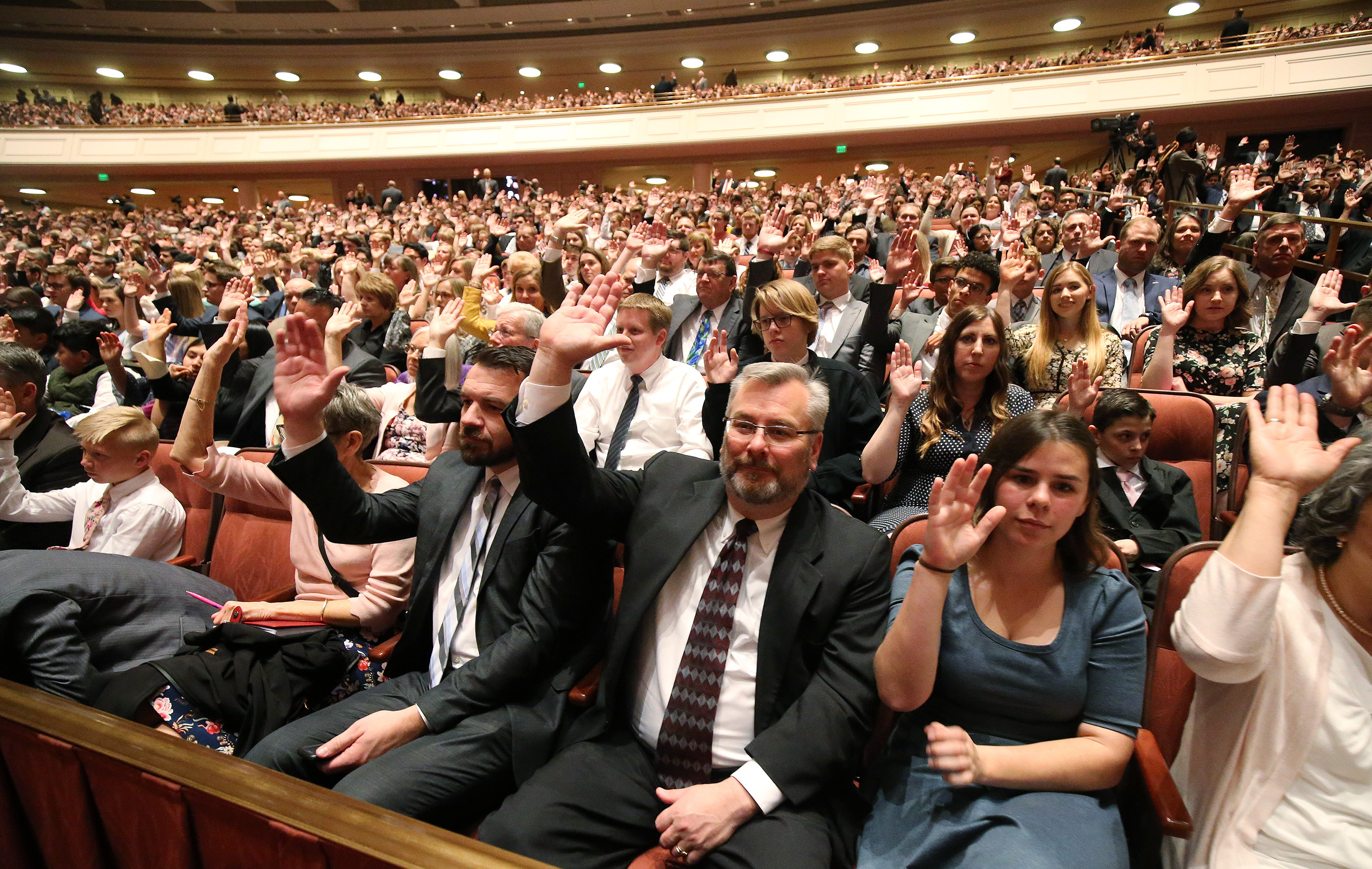 Attendees in the Conference Center sustain leaders during the Saturday afternoon session of the 189th Annual General Conference of The Church of Jesus Christ of Latter-day Saints in Salt Lake City on Saturday, April 6, 2019.