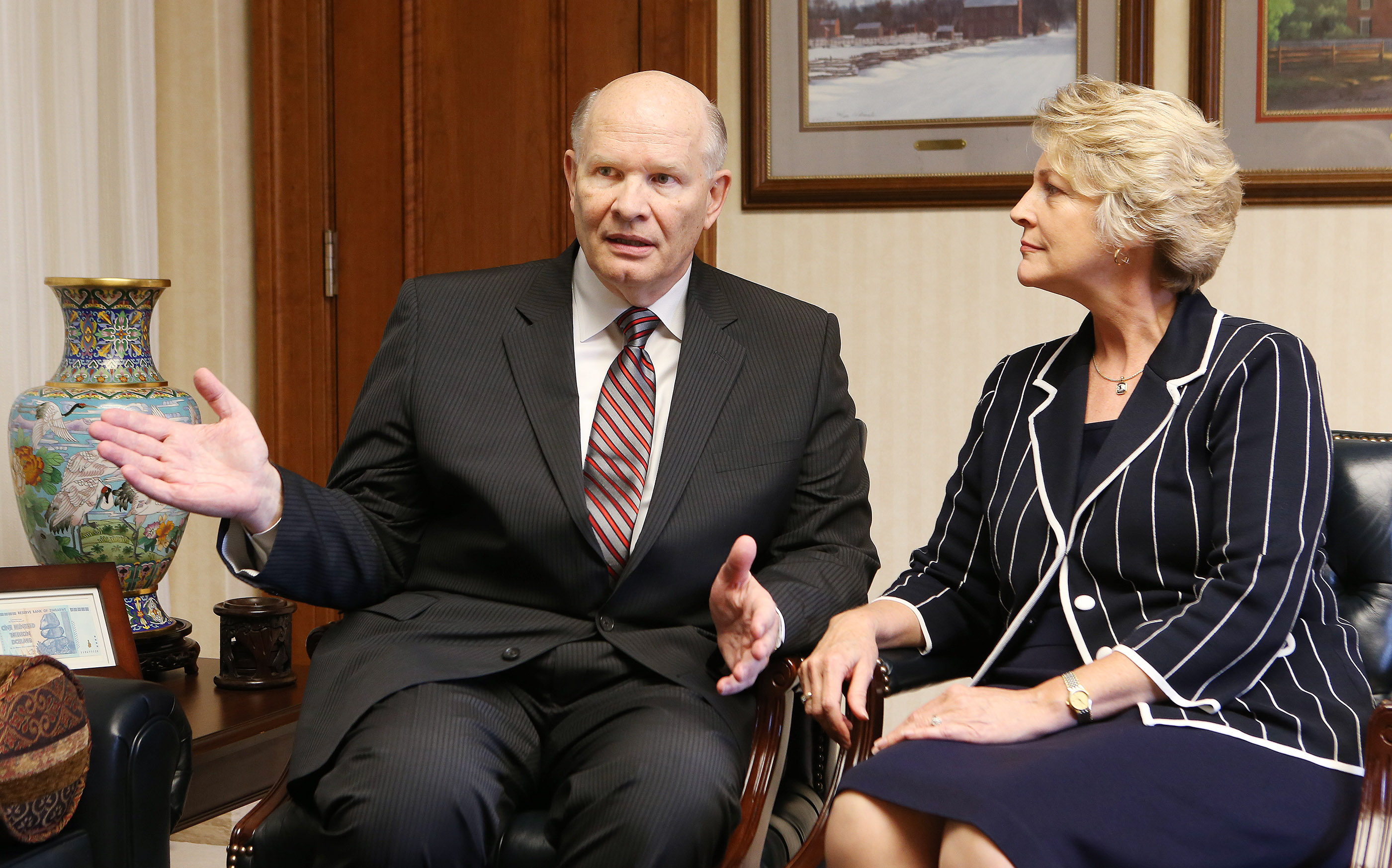 Elder Dale G. Renlund is interviewed shortly after his call to the Quorum of the Twelve Apostles in October 2015. He is pictured with his wife, Sister Ruth Renlund.