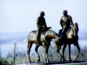 """The Mississippi River is the backdrop for a statue entitled """"Calm As A Summer's Morning,"""" placed near the Nauvoo Illinois Temple. The statue depicts Joseph Smith and his brother Hyrum on horseback, riding to Carthage where they were martyred."""