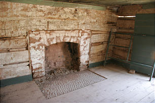 The original adobe fireplace still stands in the Louisa Foster Russell Home, a gabled wood structure built by Alonzo H. Russell between 1873 and 1879 for his wife Louisa and their six children.