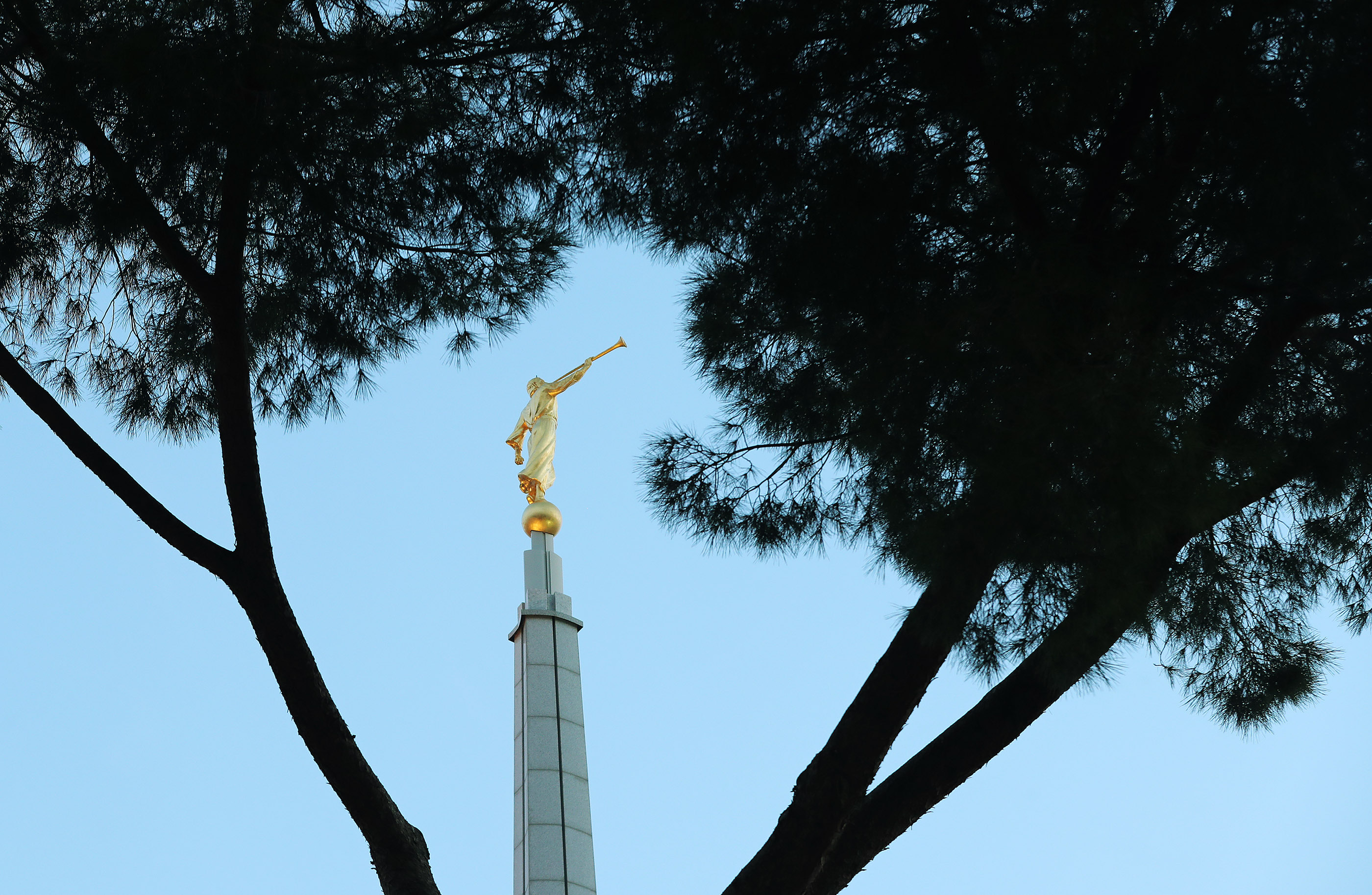The Angel Moroni statue of the Rome Italy Temple of The Church of Jesus Christ of Latter-day Saints at sunrise in Rome, Italy, on Friday, March 8, 2019.