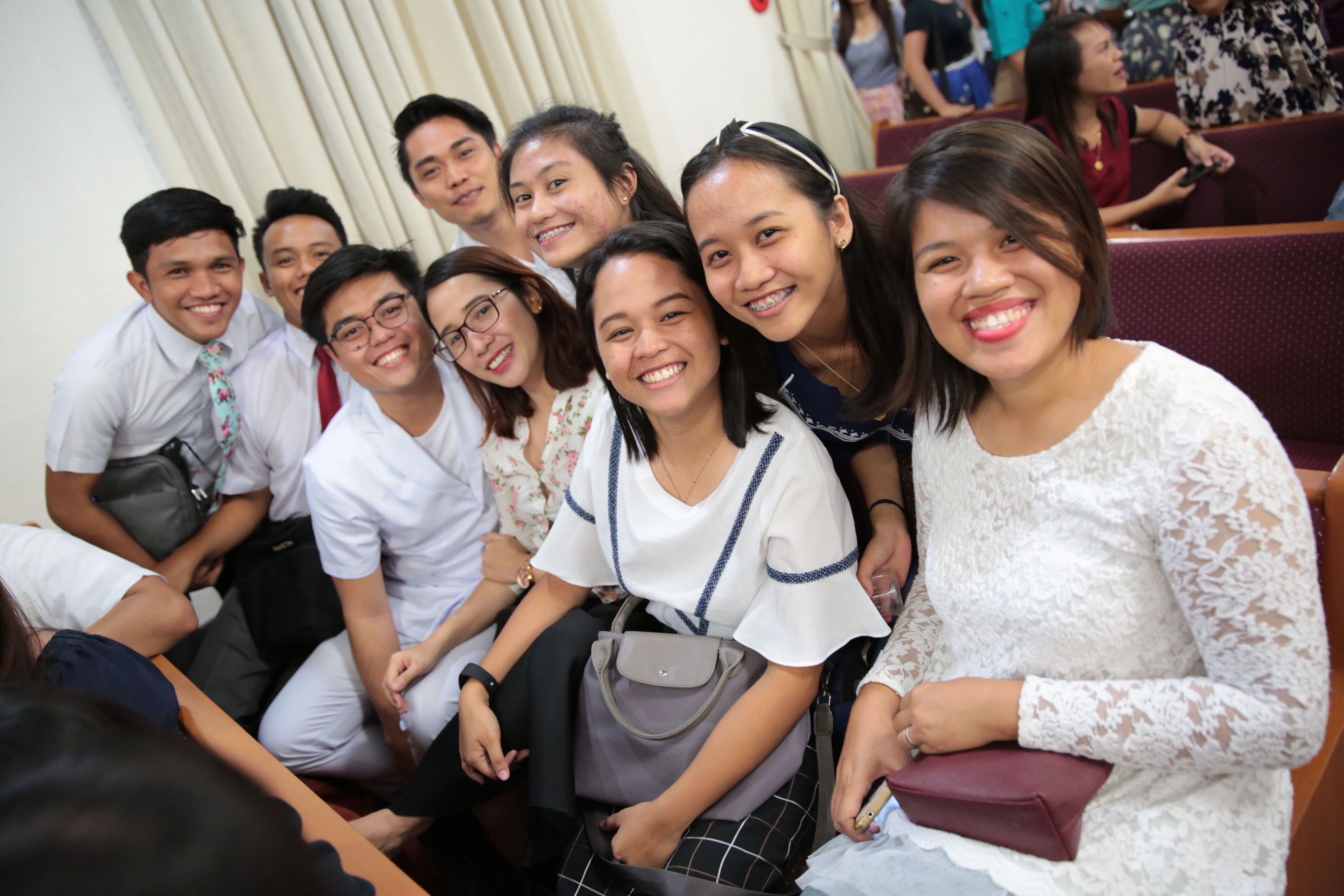 Young Filipinos gather to listen to counsel from Elder D. Todd Christofferson and other visiting General Authorities.