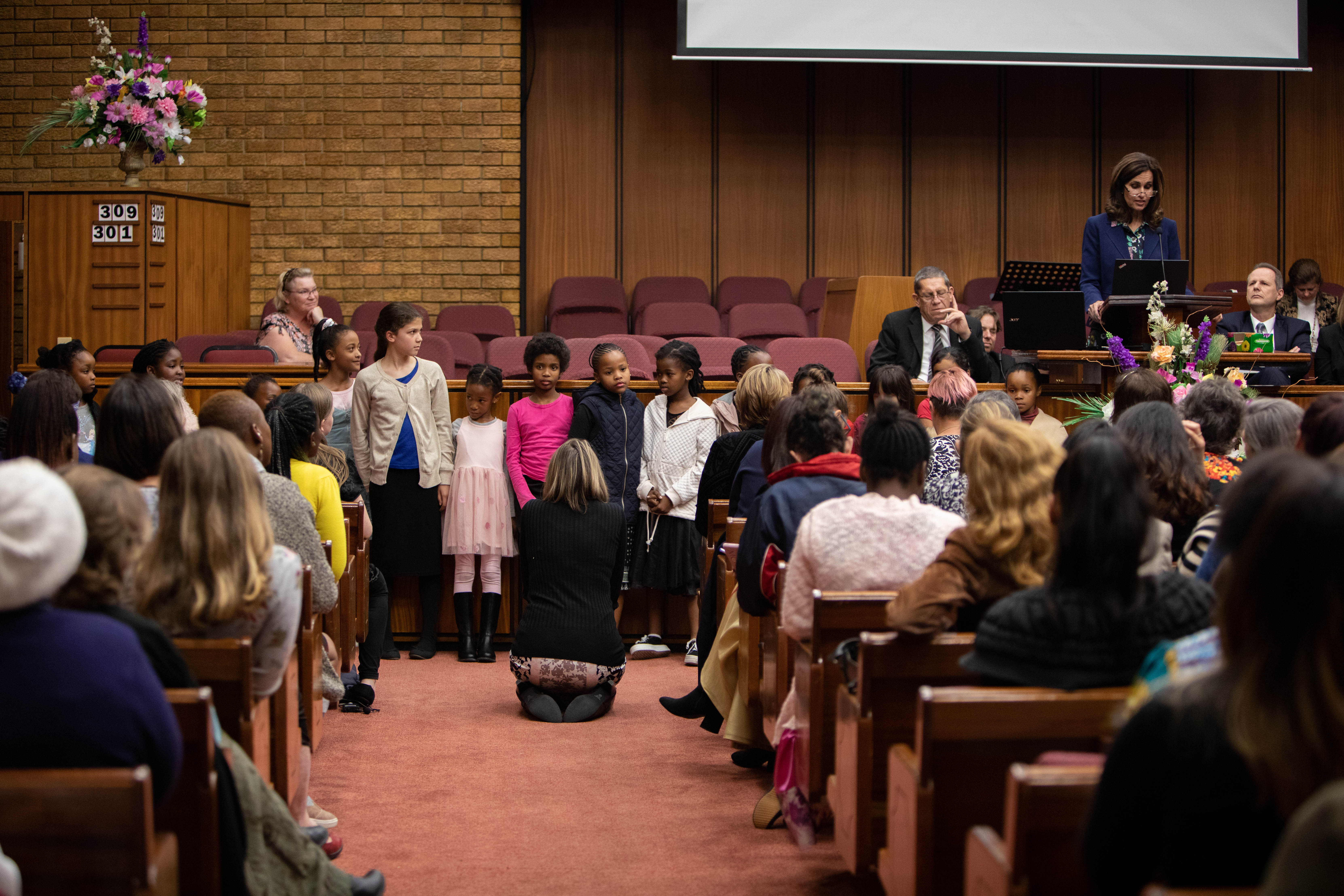 Youth members gather at the front of the chapel during a training with Sister Lisa L. Harkness in Cape Town, South Africa, in May 2019.