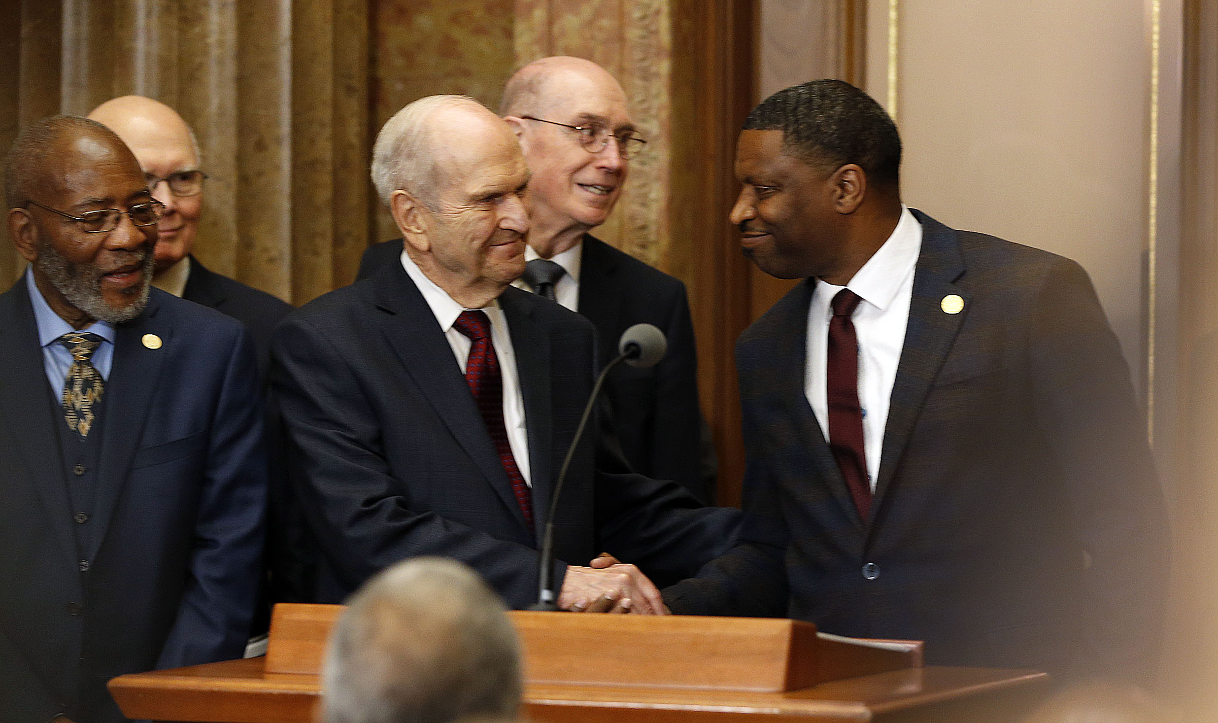 President Russell M. Nelson of The Church of Jesus Christ of Latter-day Saints shakes hands with National President Derrick Johnson of the NAACP, right, during a press conference in Salt Lake City on Thursday, May 17, 2018.