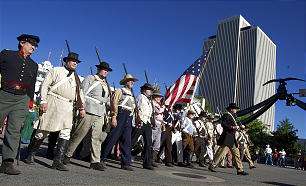 People representing the Mormon Battalion march in the parade as spectators watch the floats, horses and celebrities participate in the Days of '47 Parade in Salt Lake City on July 24, 2010.