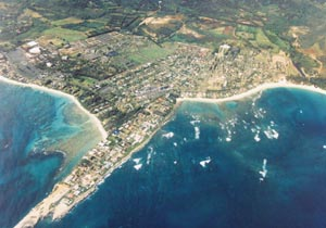 In aerial photo of Laie, Hawaii, one can see the BYU-Hawaii campus and Polynesian Cultural Center in middle left, where once grew taro patches.