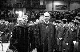 Then-Elder Russell M. Nelson of Quorum of the Twelve, right, and Ricks College President David Bednar lead processional of final April graduation before college becomes BYU-Idaho.