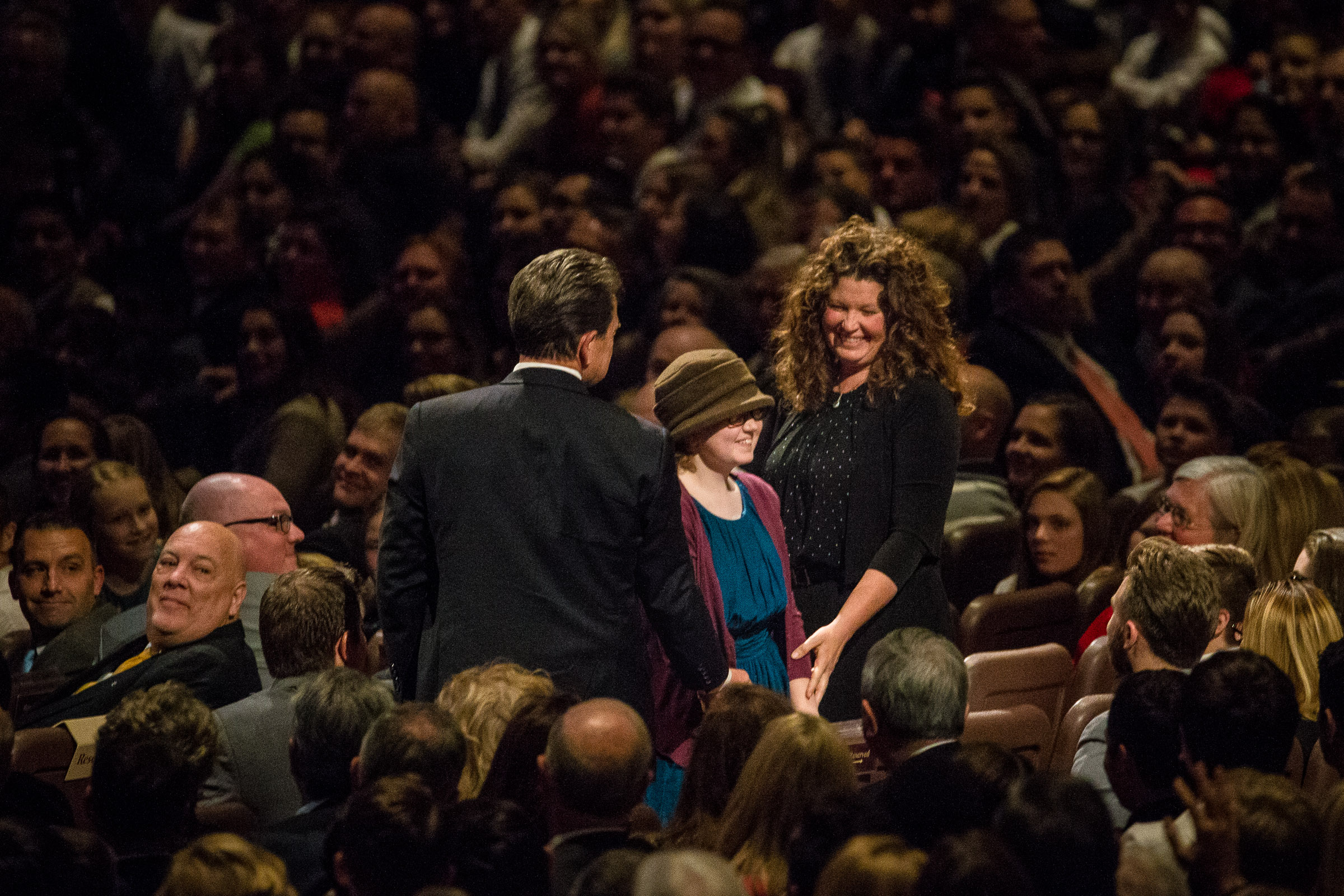 Stephen Terry, left, Lydia Terry, 12, and Kellie Terry stand up and are recognized during President Russell M. Nelson's speech at the First Presidency's Christmas Devotional in the Conference Center in Salt Lake City on Sunday, Dec. 2, 2018. Lydia, of Bountiful, suffers from a rare, aggressive form of brain cancer.